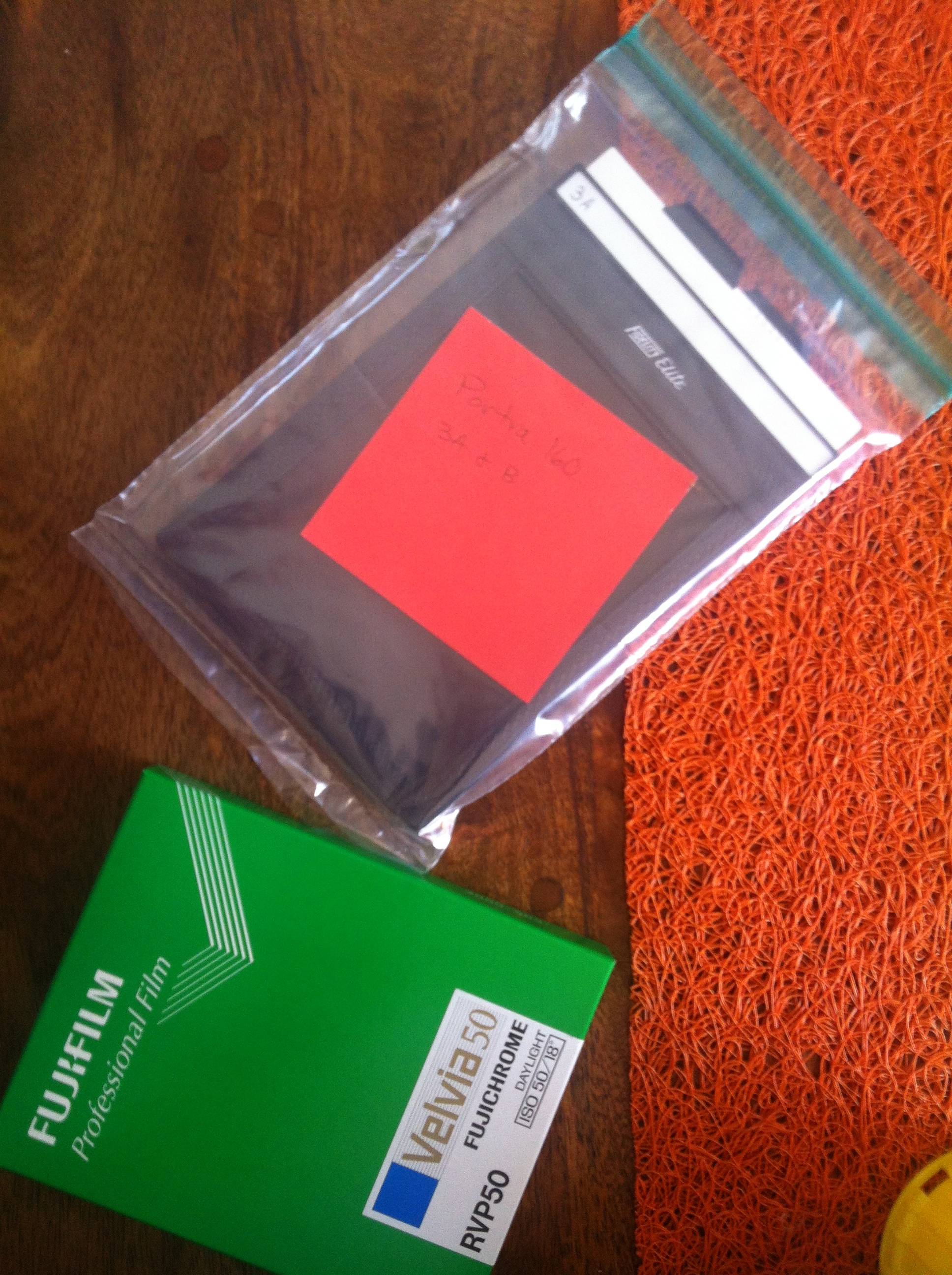 The special ziploc has a pocket which is used to place the identification note. It does not touch the film holder