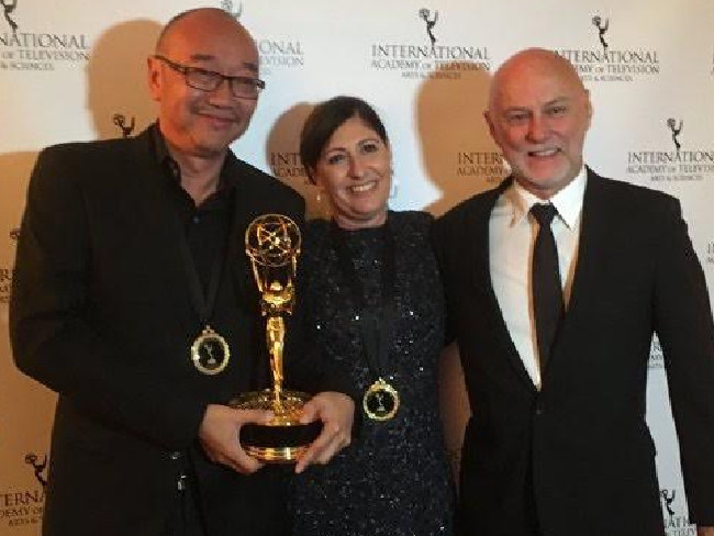Tony Ayres, Beth Frey and Michael McMahon with their Emmy award for Nowhere Boys.