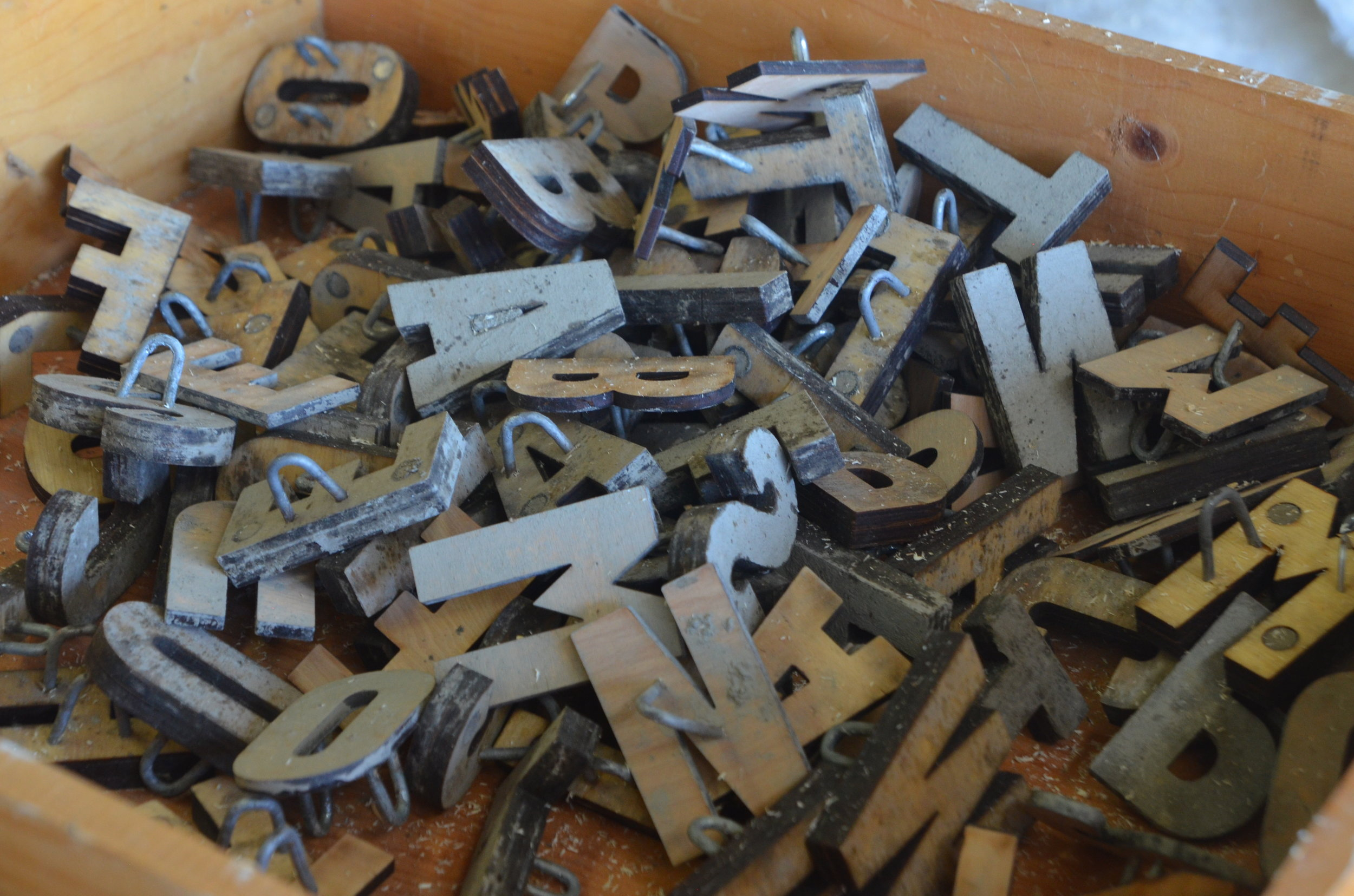 Wooden letters used to imprint words into earth.