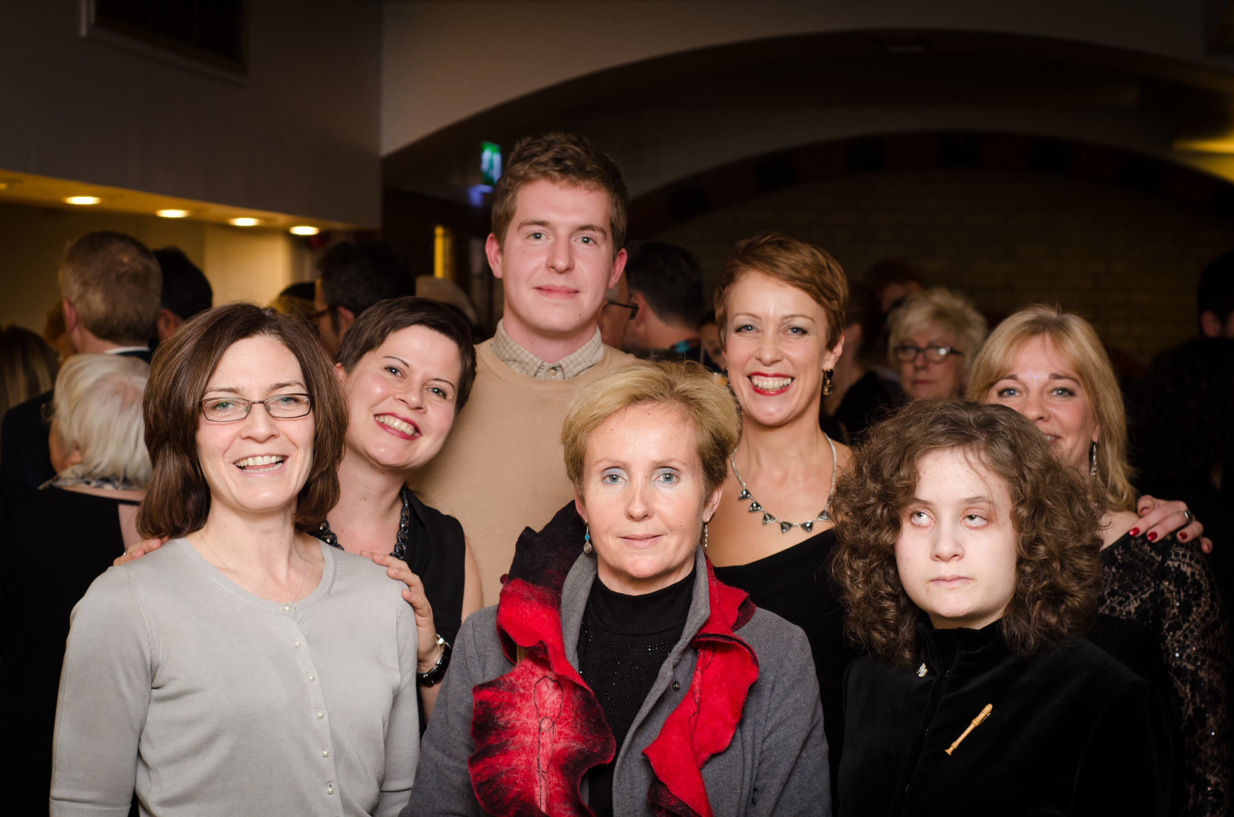 Alexia Sloane with her mother Isabelle and members of the Dosoco team at The Dowsing Sound Collective Christmas gig, during which Dosoco's awards were announced.