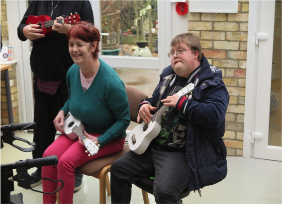 Jeanette and David, playing the ukuleles bought with Dosoco grant money