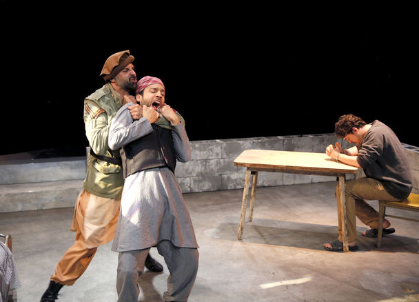 """Elijah Alexander as """"Bashir"""" in Ayad Akhtar's """"The Invisible Hand"""" at ACT Threatre in Seattle, WA."""