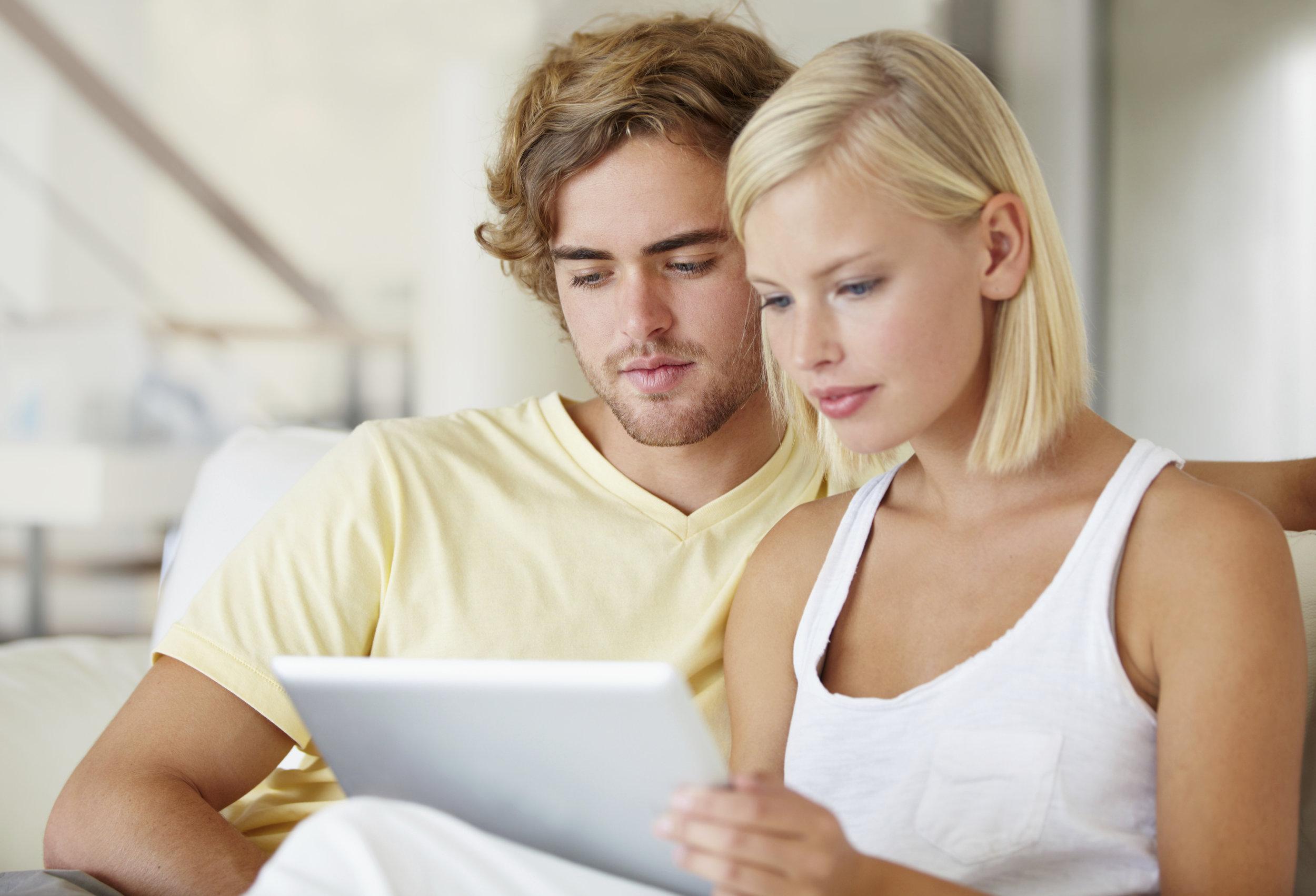 Happy Couple w Tablet.jpg