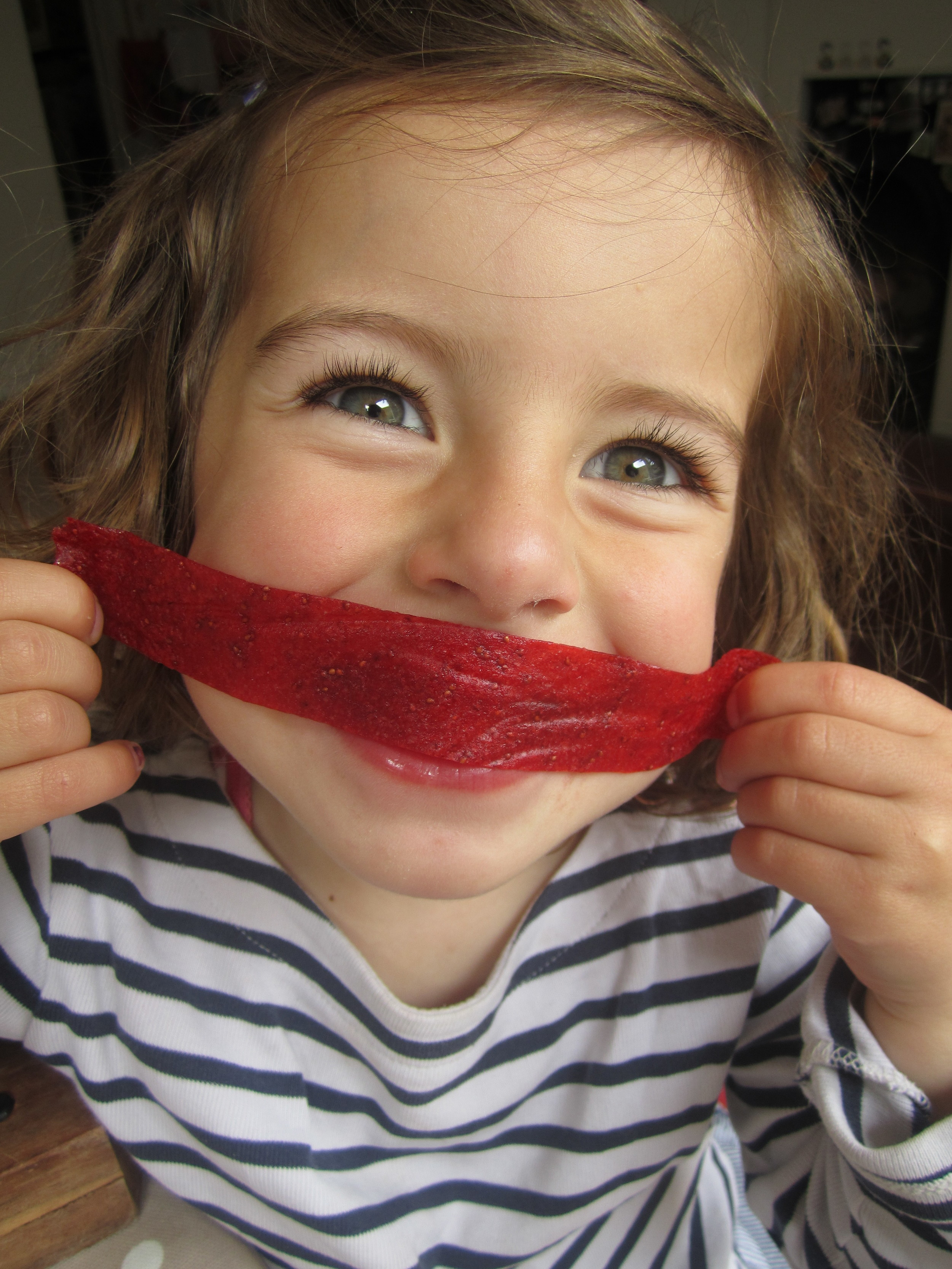 Ivy with a roll of Strawberry fruit leather