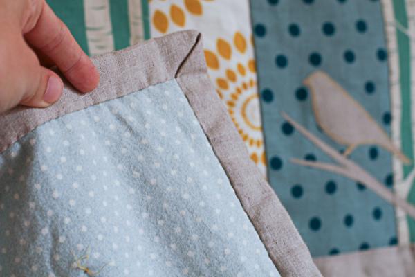 Linen cot quilt with a flannelette back.