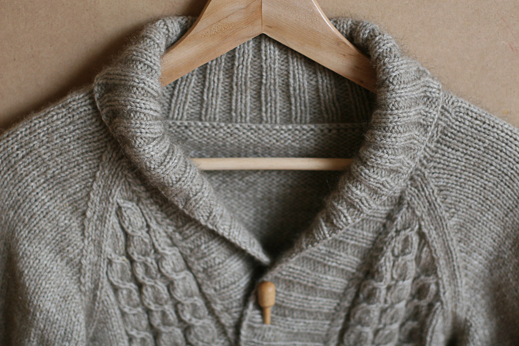 I don't wear shawl collared cardigans! Pattern is Forestry by Vogue knitting. Knitting by me.