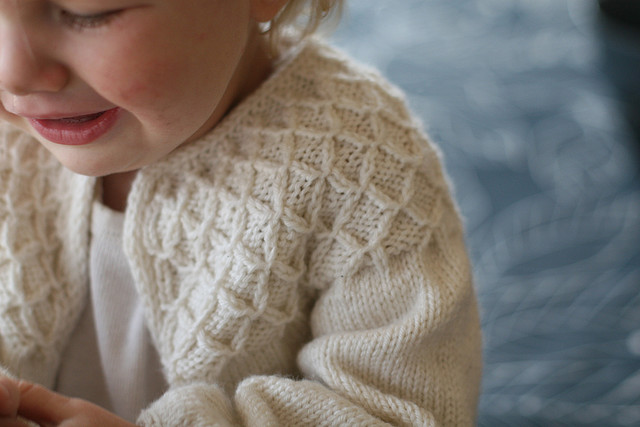 I used EZ's EPS to get the numbers for this little jumper. Pattern was originally Ysolda's Coraline for women.