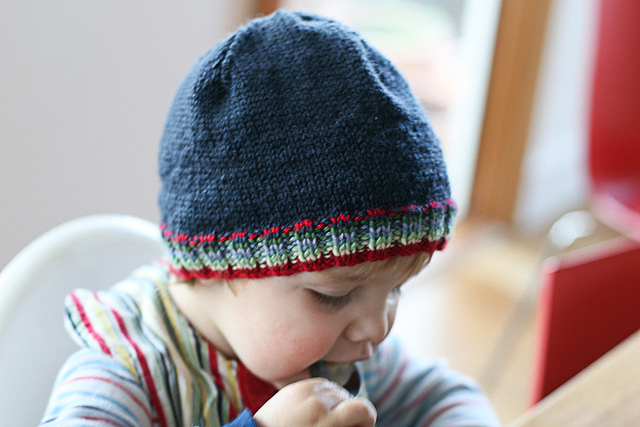 Beginner knitting by me about seven years ago. Admire the uneven tension and dodgy wool. BUT I made a hat - for my small person - with love!!