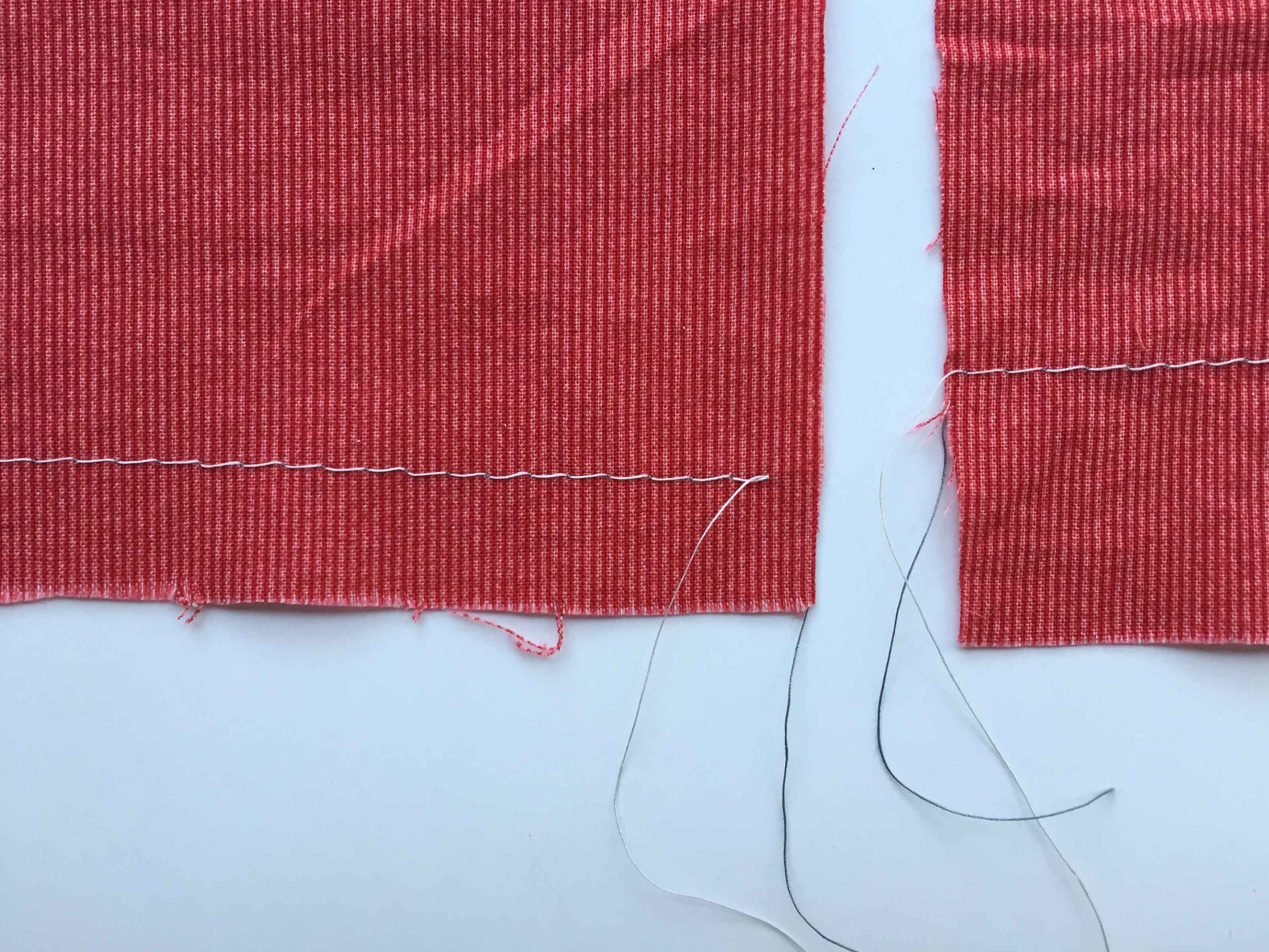 The basting stitch on the left was sewed at 1.5cm and the one on the right at 2.5cm. I also do some at about 4 or 5cm - whichgives a heavier hem. Contrasting thread on the right side of the fabric.