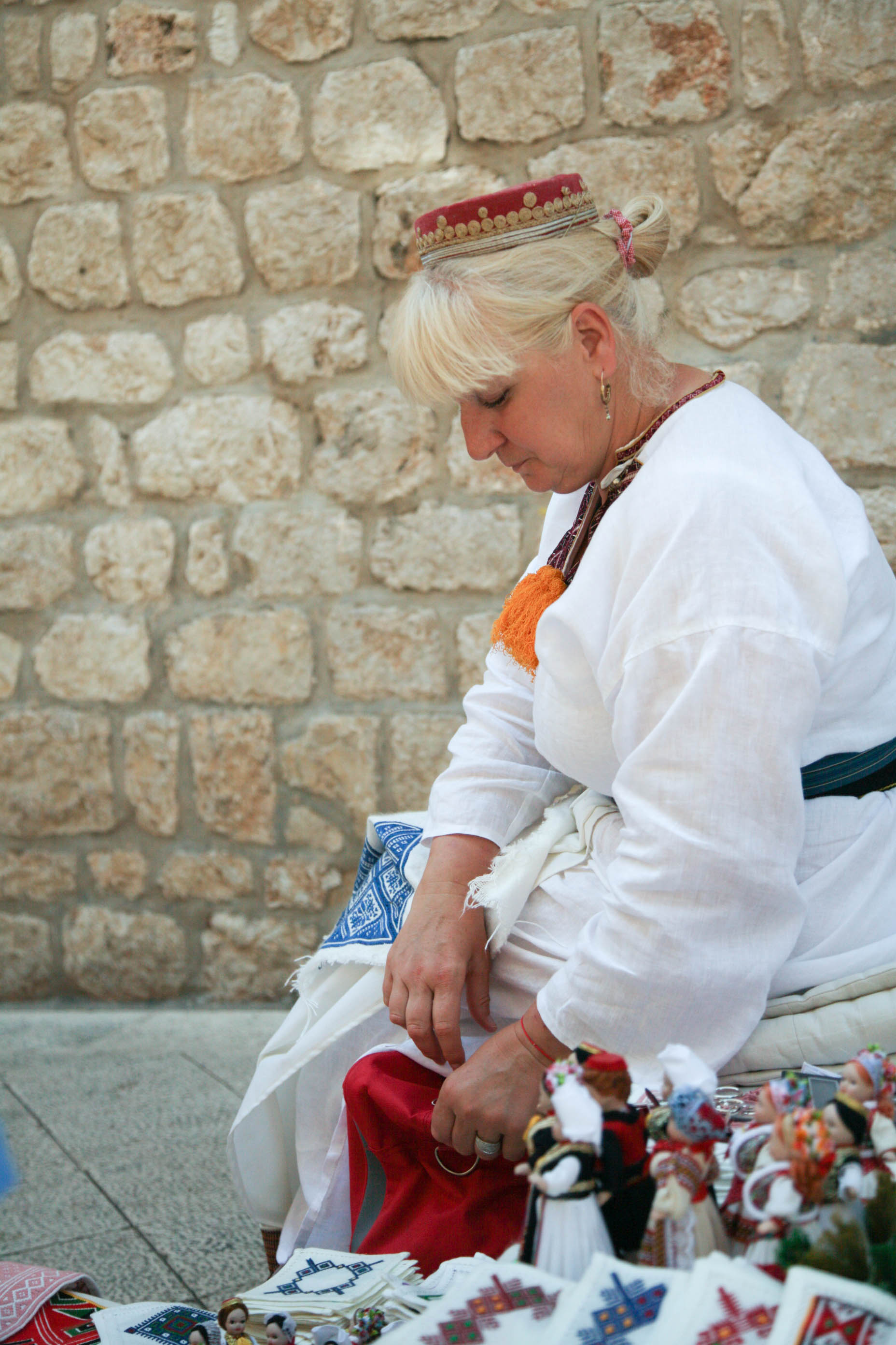 This lady was sewing on the street.