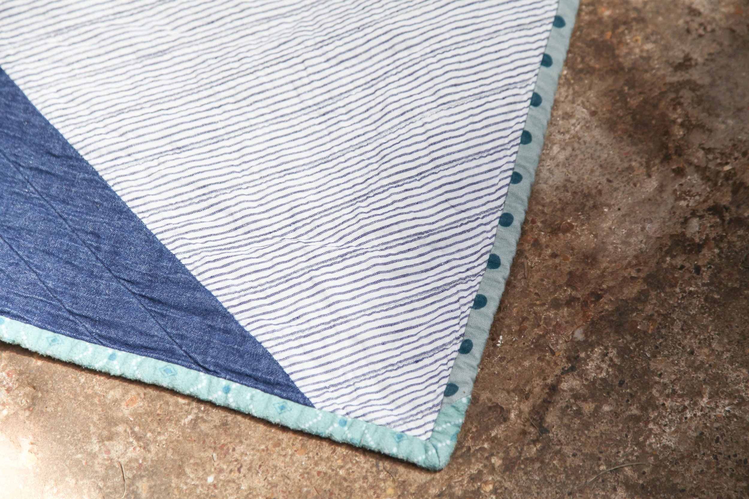 Biasing and lumps on my little boy's quilt. And yes some of that binding is flanellette. And the spots are a thick cotton/linen blend. Not a quilting cotton in sight :).