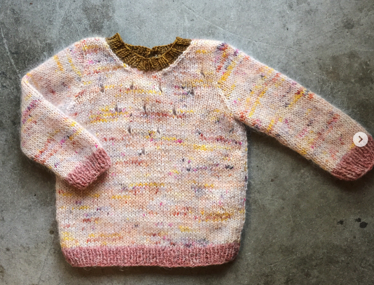 This sweater was made with one strand of scrap mohair and one strand of sock yarn. It pulled the yarn colours together and altered the weight of the yarn which made it perfect for this sweet  Iris Sweater by Wiksten Made .