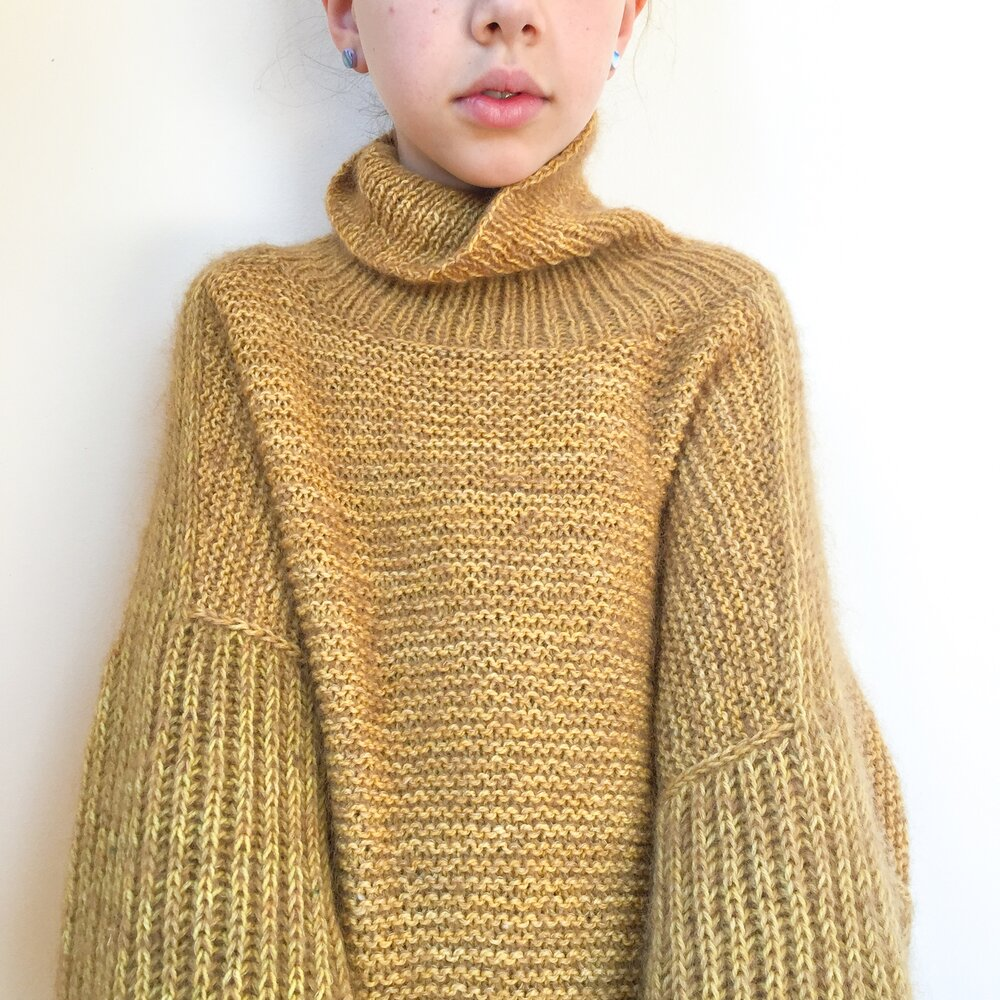 Sweater is grown up sized - but modelled by a 9yo who likes to wear it as a dress.