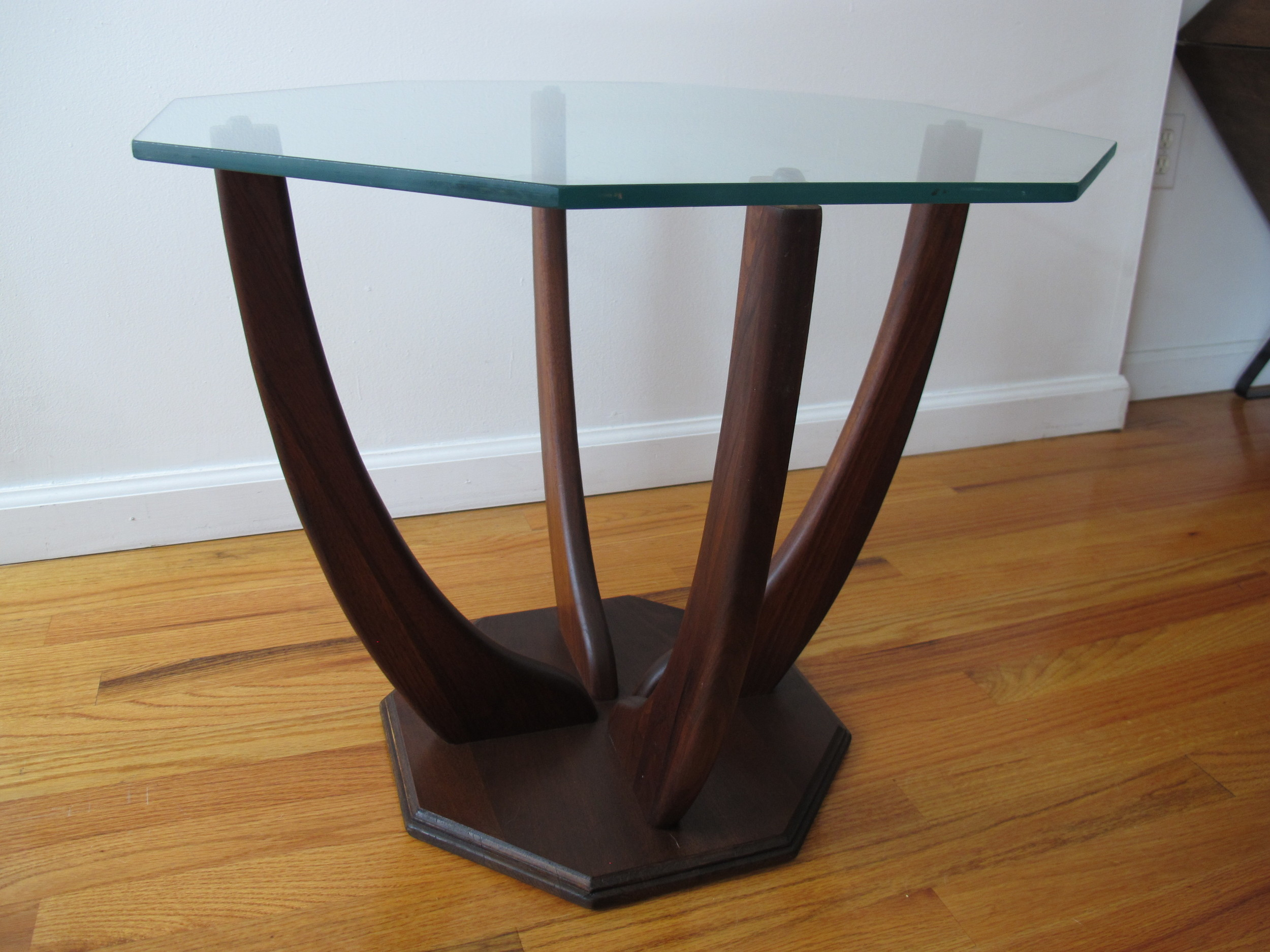 MID CENTURY GLASS TABLE WITH SCULPTED WOOD BASE