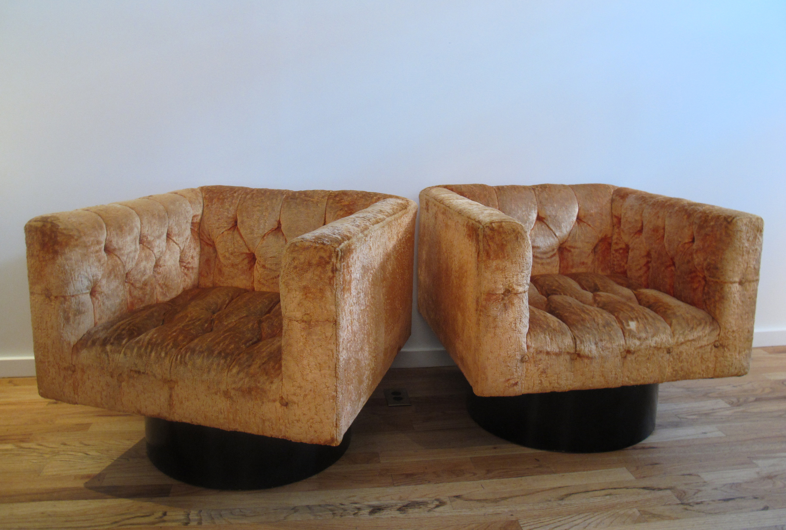 MID CENTURY SWIVEL LOUNGE CHAIRS AFTER MILO BAUGHMAN