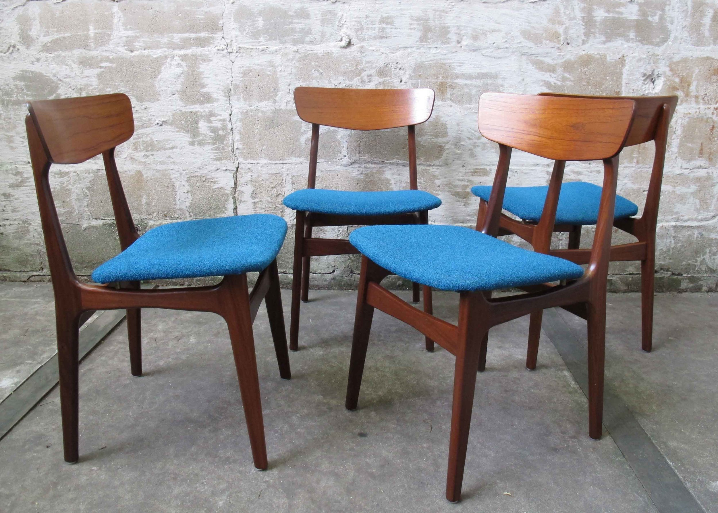 FOUR DANISH MODERN SCULPTED TEAK & WALNUT DINING CHAIRS WITH BRASS FITTINGS