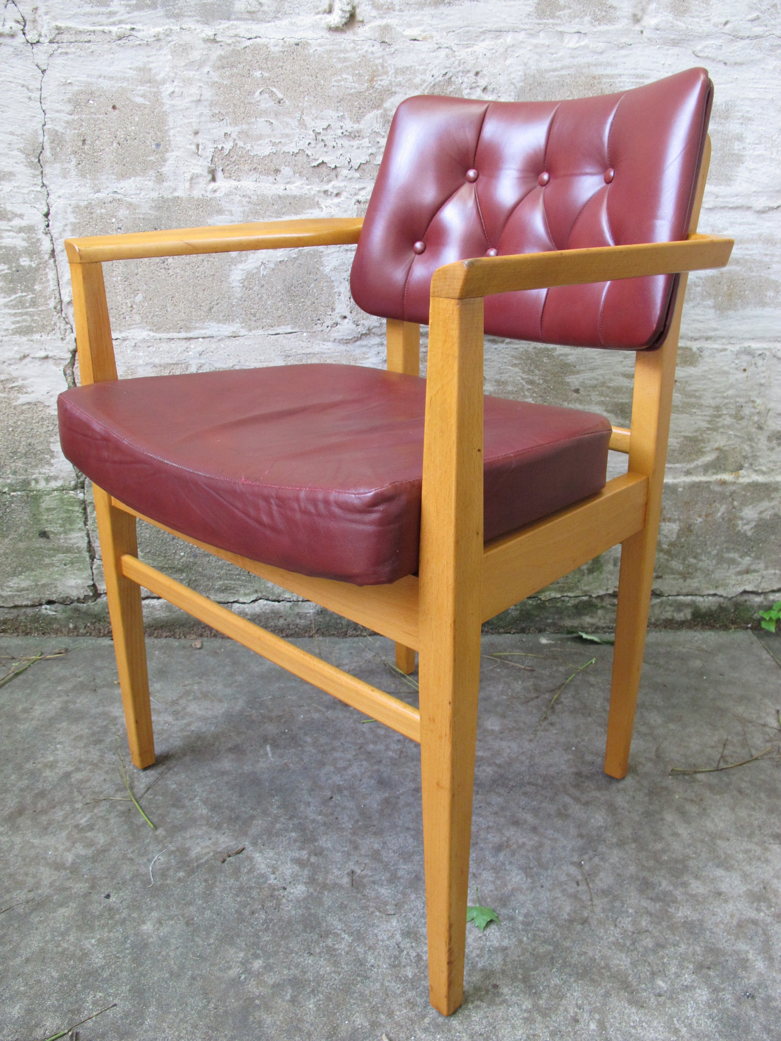 MID CENTURY LEATHER ARM CHAIR BY HOWARD KEITH