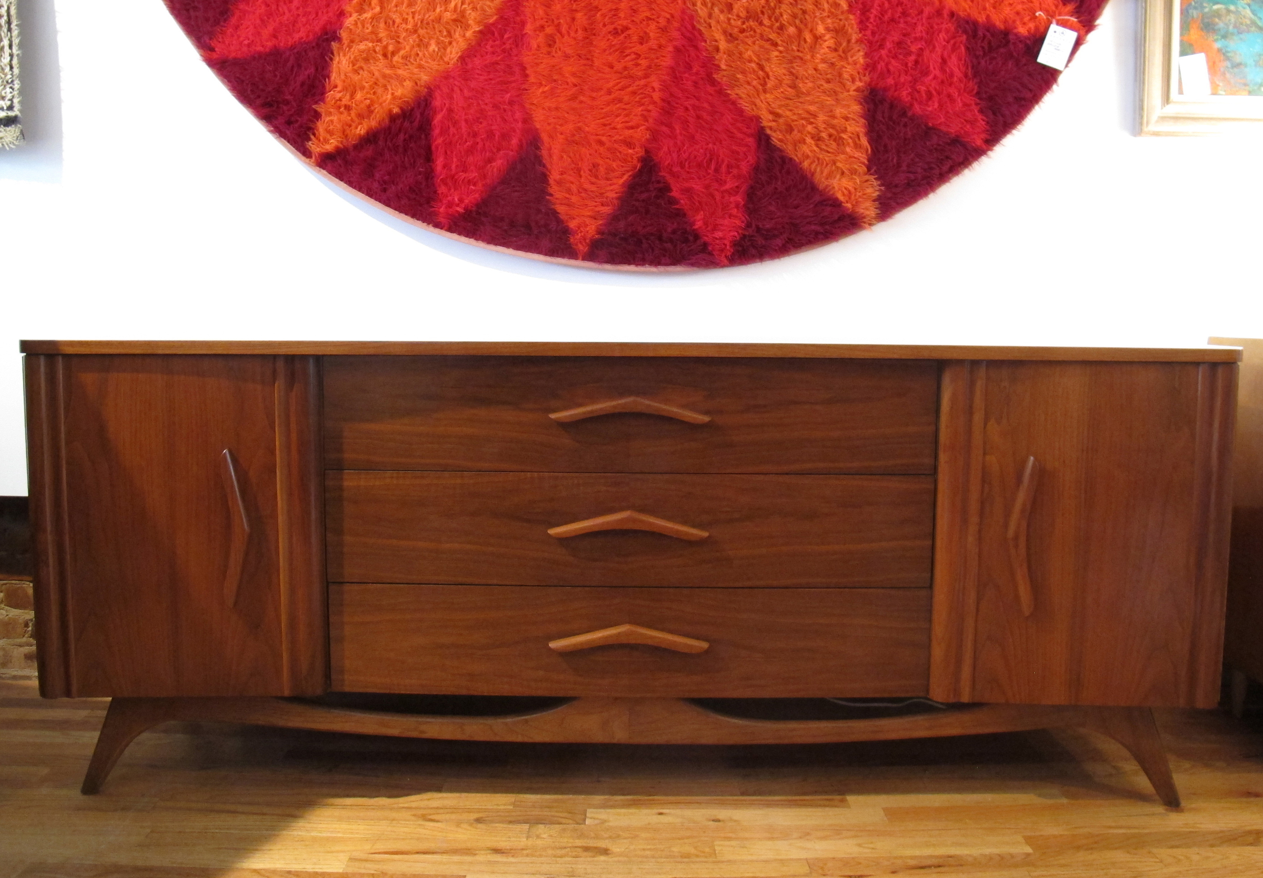 MID CENTURY SCULPTED WALNUT LONG DRESSER