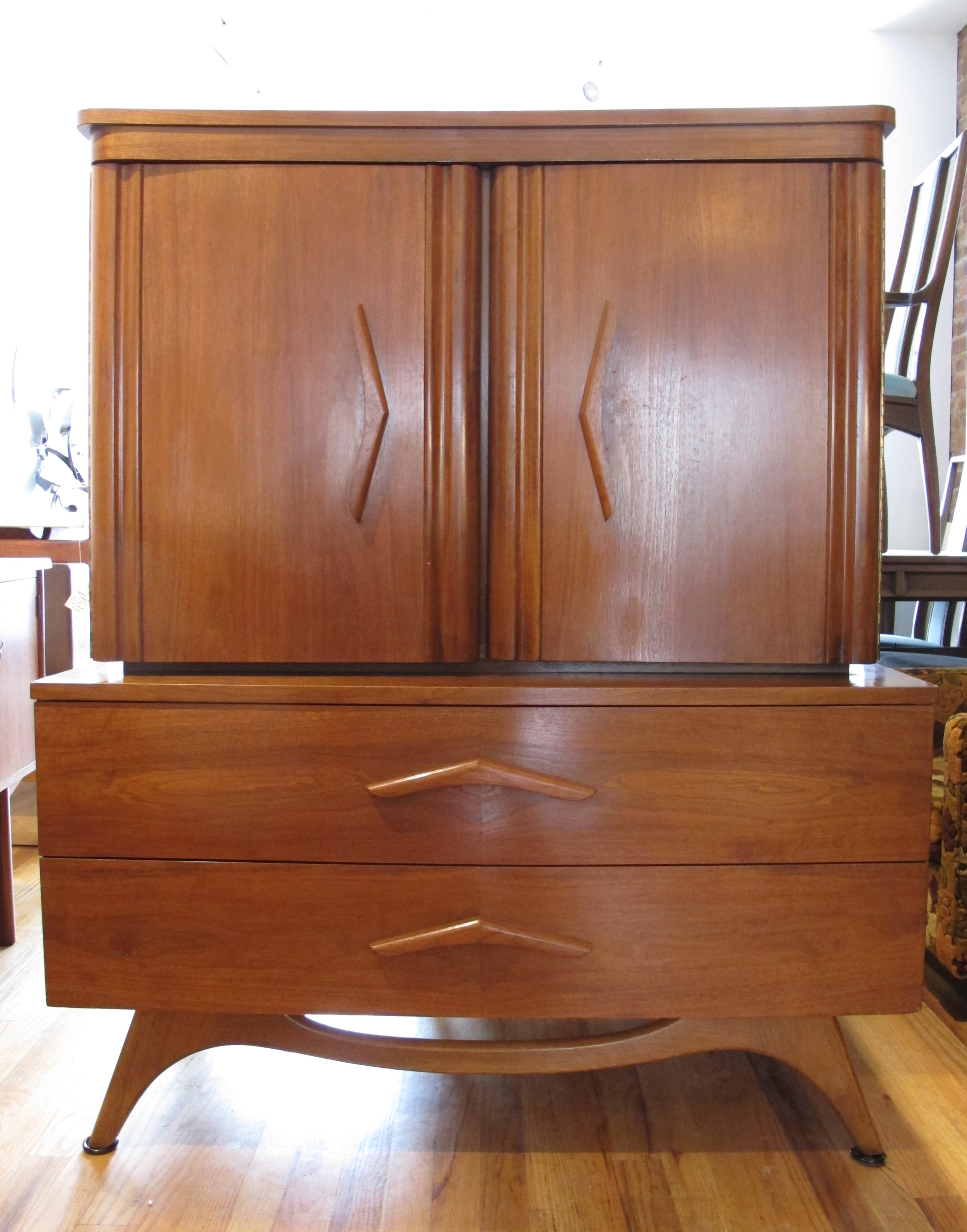 MID CENTURY SCULPTED WALNUT TALL DRESSER
