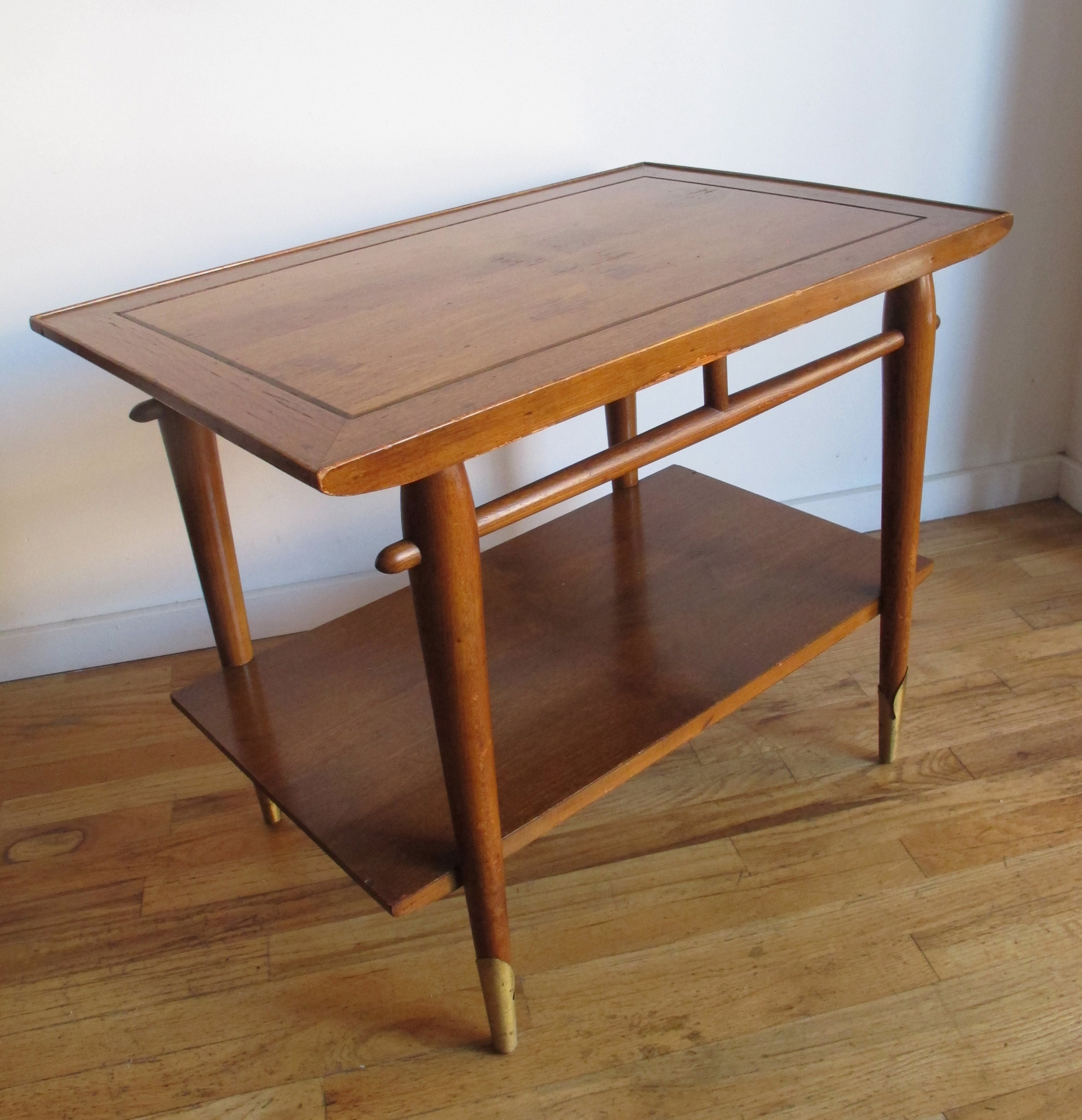 MID CENTURY TWO-TIER END TABLE WITH BRASS FEET BY LANE