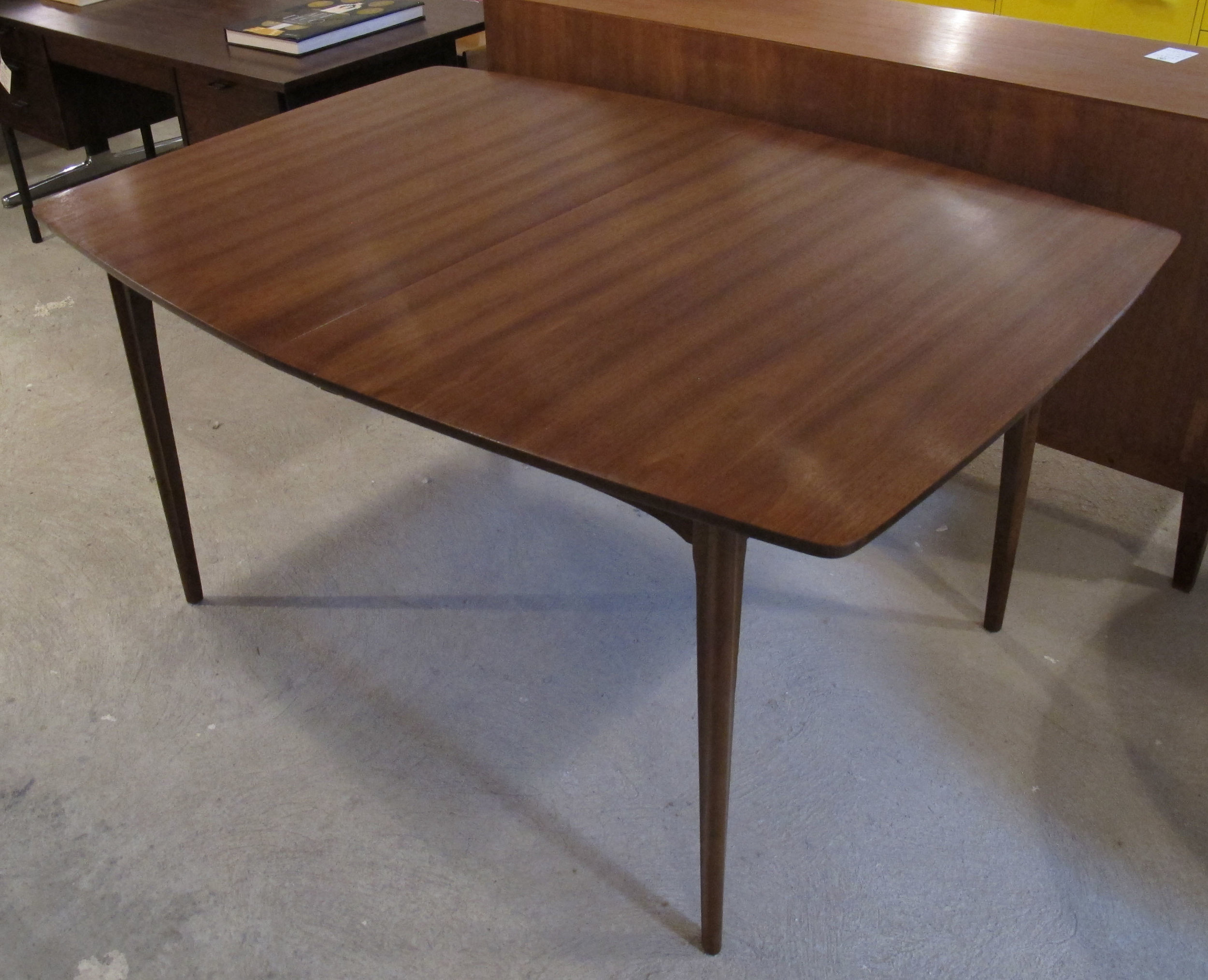 MID CENTURY WALNUT DINING TABLE BY KENT COFFEY