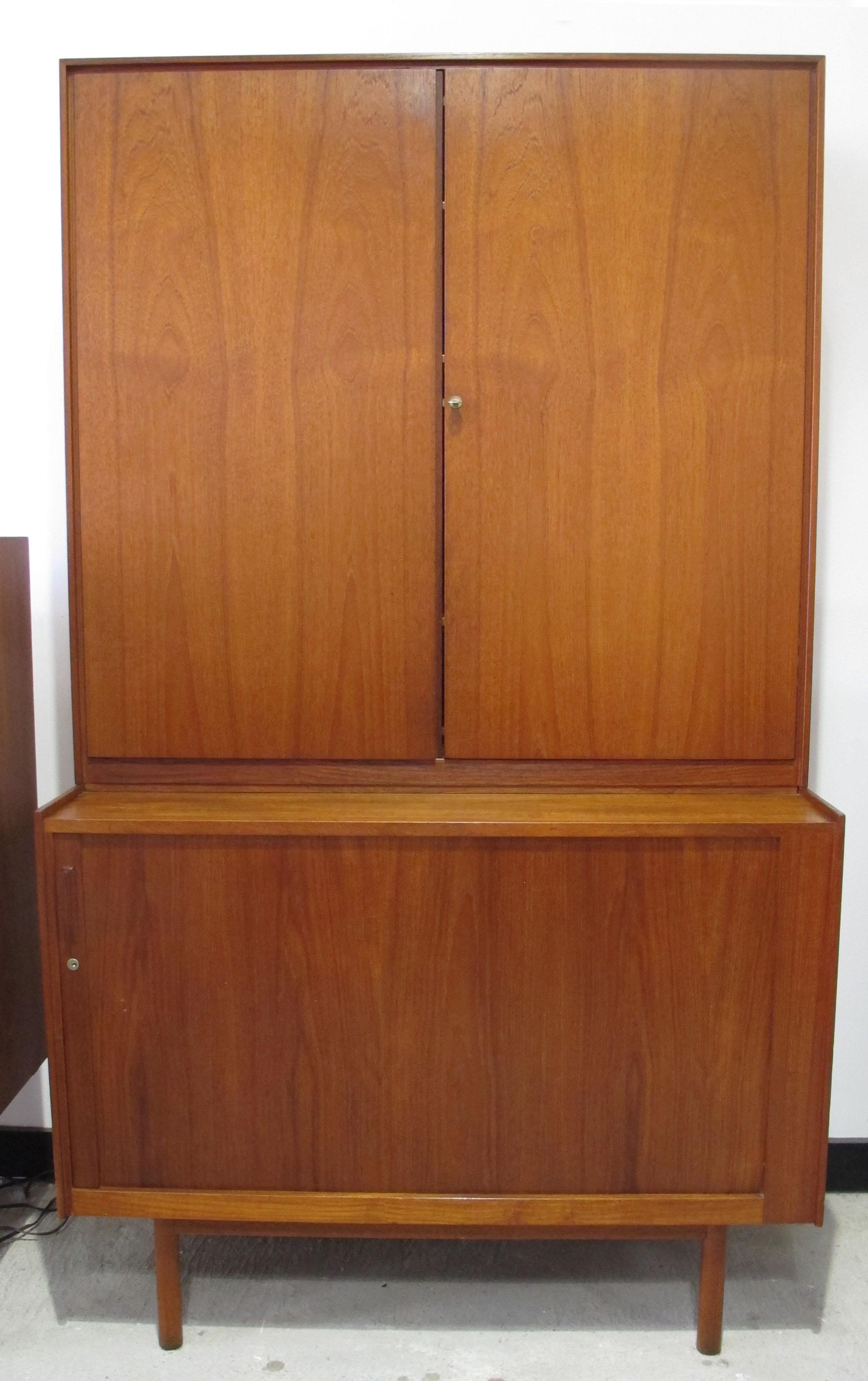 TALL DANISH TEAK CABINET WITH TAMBOUR DOOR