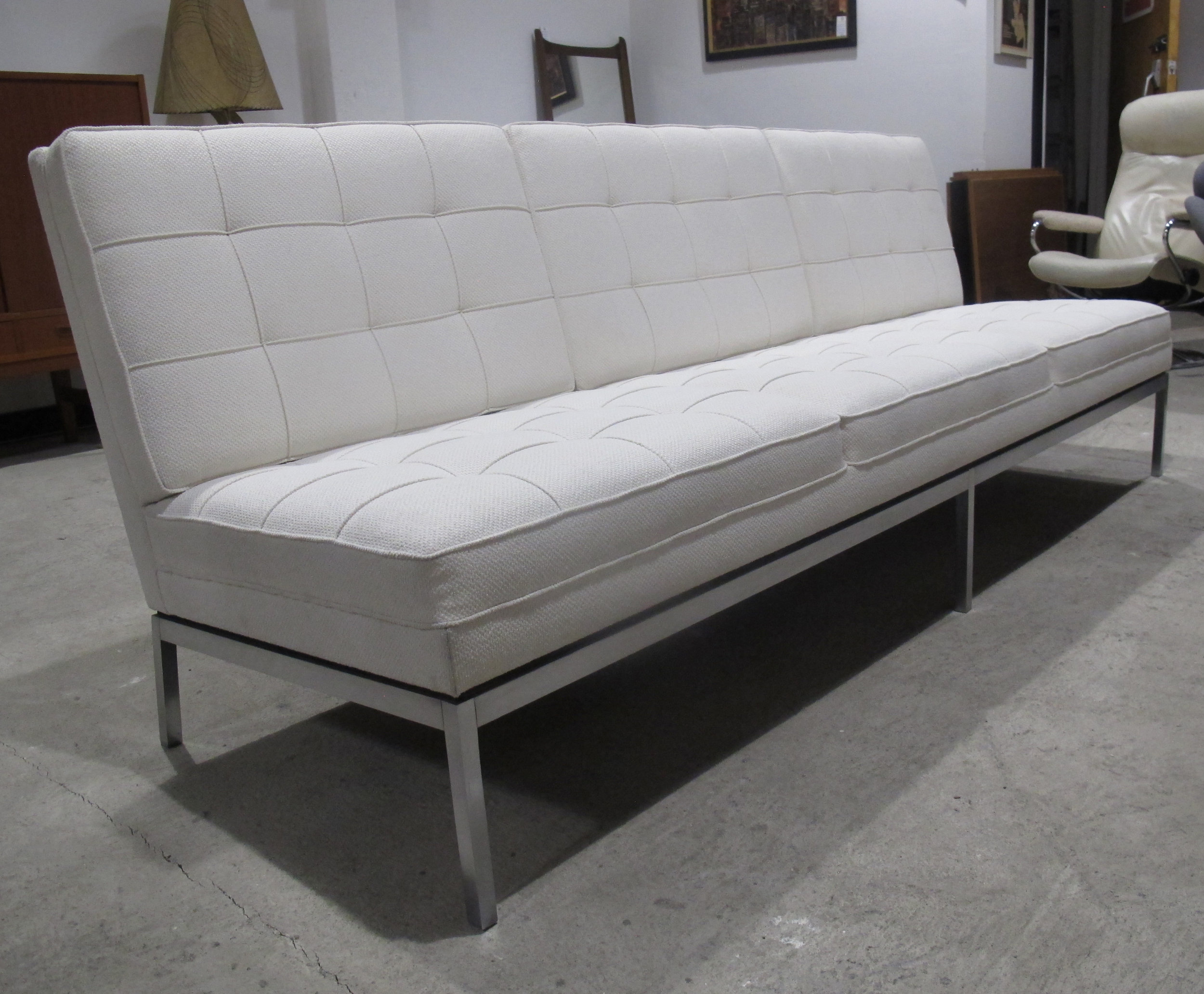 MID CENTURY FLORENCE KNOLL MODEL 67 ARMLESS WHITE UPHOLSTERED SOFA