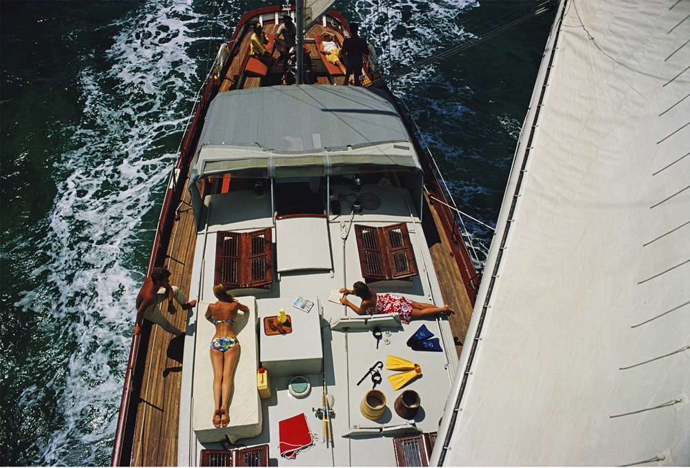 Deck Dwellers  by Slim Aarons via  Jonathan Adler