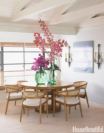 mid-century cane back dining chairs in a room by  Chris Barrett  via  House Beautiful