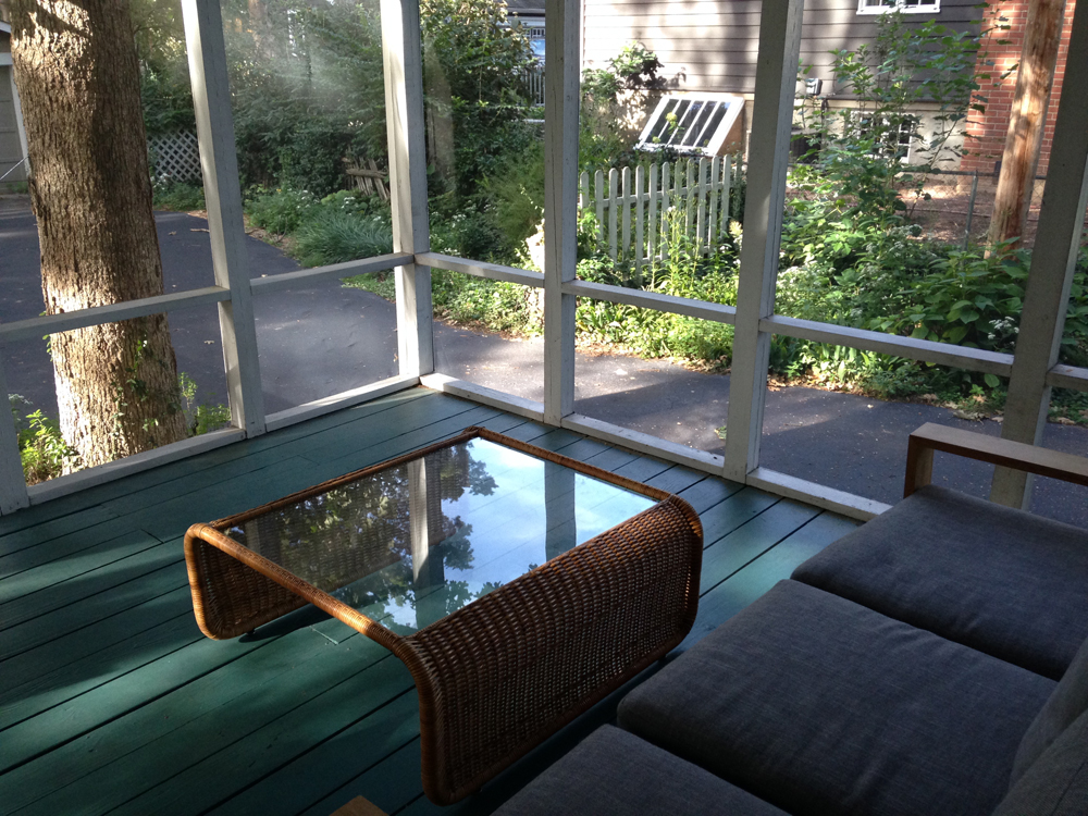 screened in porch with newly purchased table
