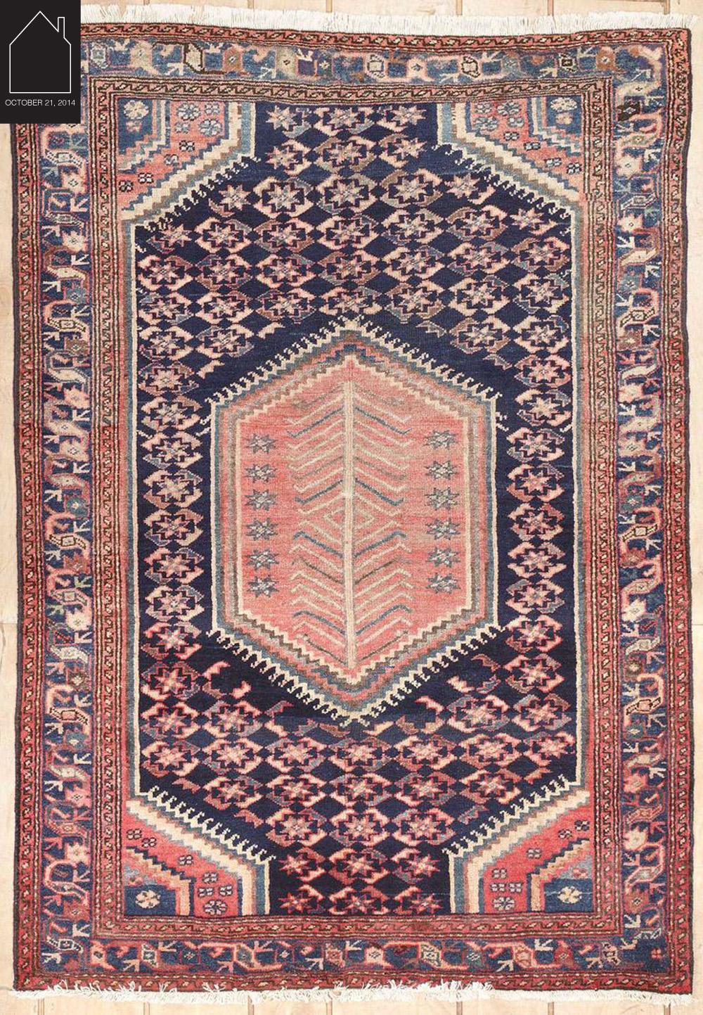 semi antique Persian rug via  Medallion Rug