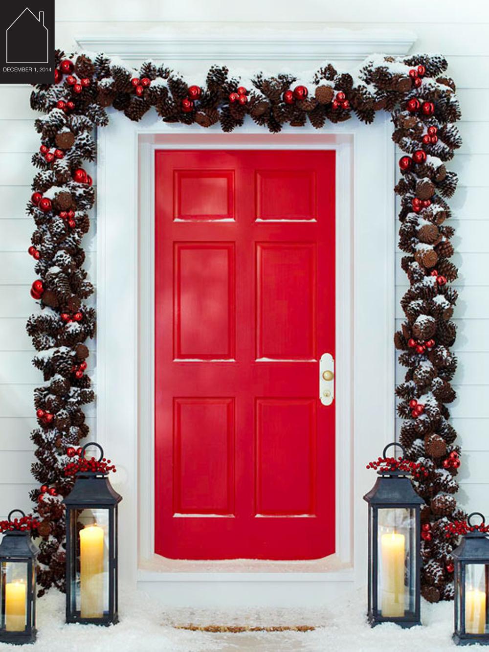 front door garland via  Better Homes & Gardens