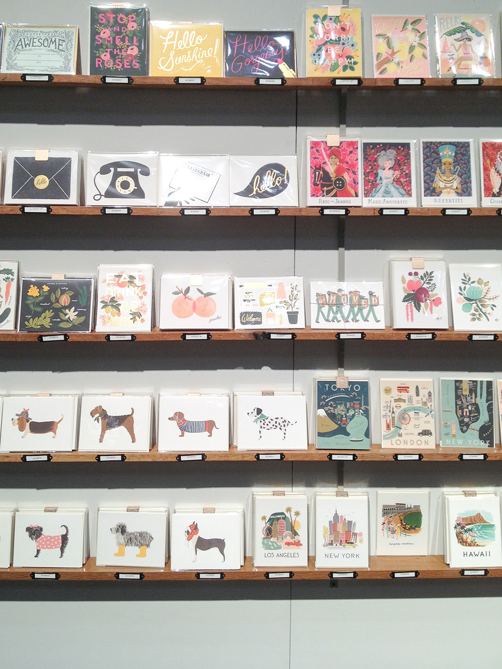 Just one of the many walls full of cards in the   Rifle Paper Co.   booth.