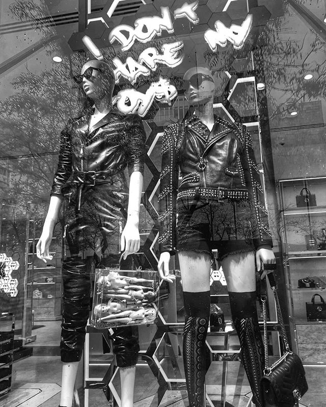 I don't like to share my toys either.  #street #blackandwhite #reflection #windowshopping #bnw_spain