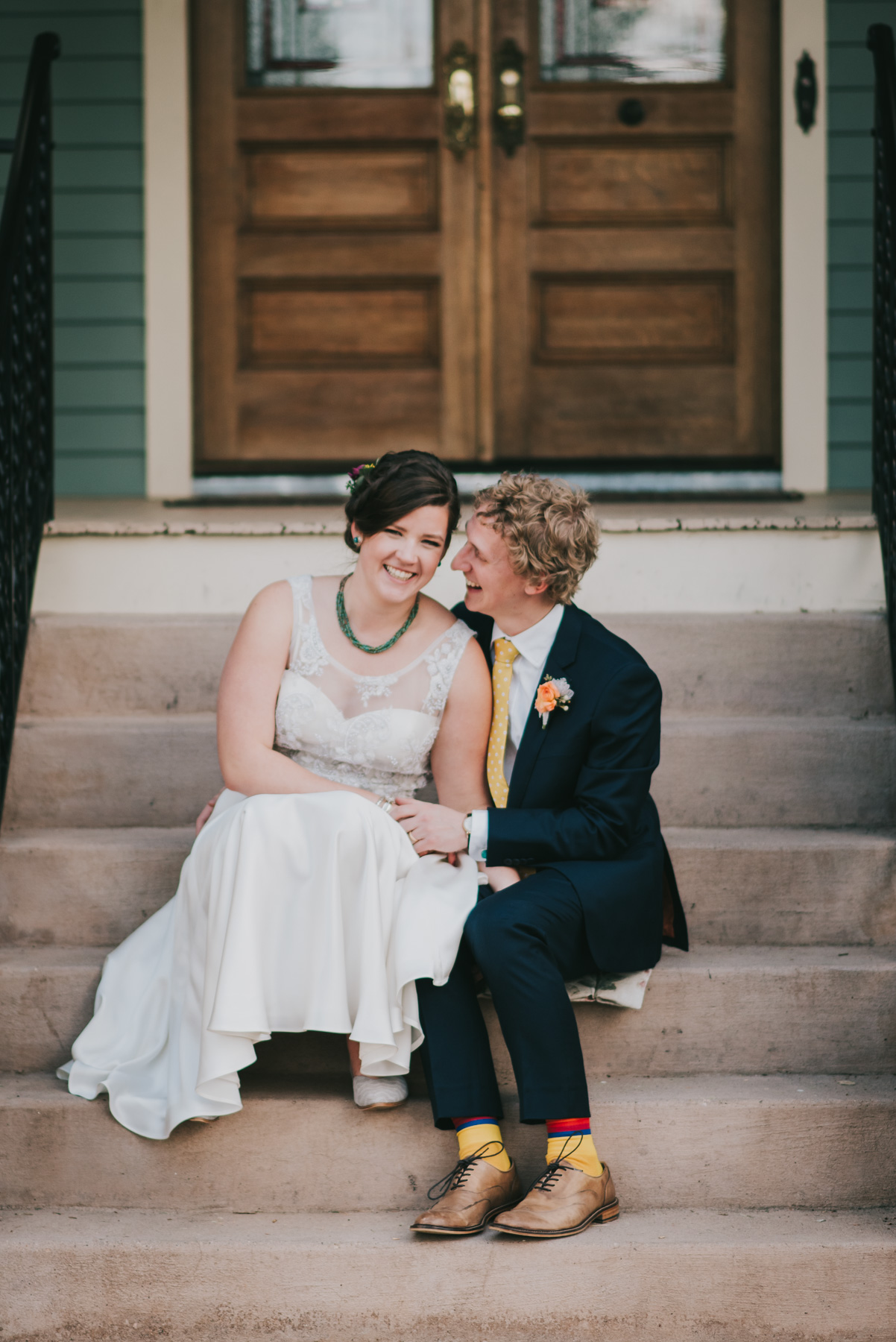 Casey and Matthew were two of my most fun couples this year. I laughed a ton, and their positive attitudes were contagious! They are sitting on the back steps of the Tapestry House in Fort Collins, Colorado on their wedding day. I love the grooms yellow, fun socks!