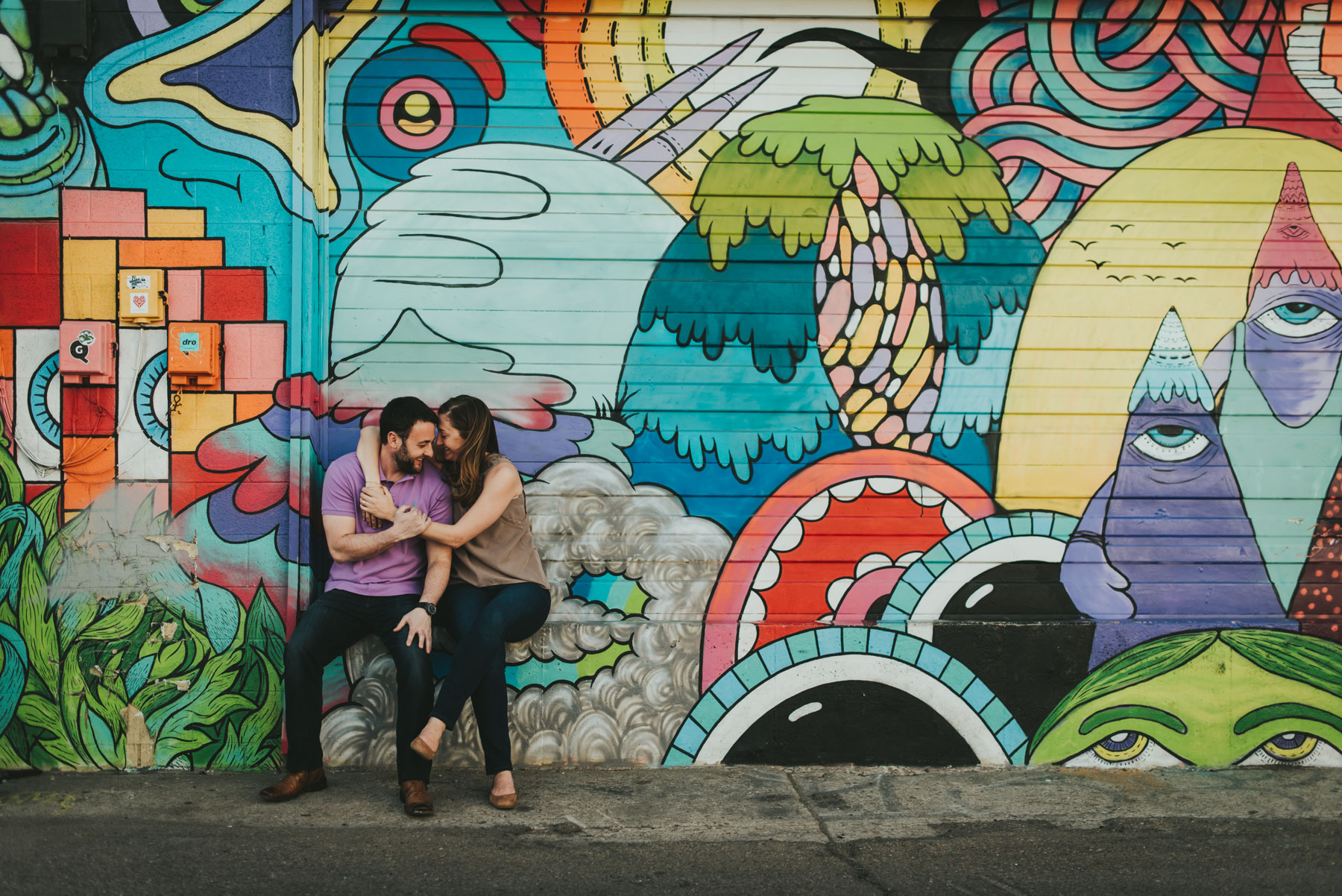 Geoff and Lindsey had their engagement session in the RiNo district in Denver, Colorado. Rino is an awesome spot for couples portraits because of the beautiful, colorful murals located between Larimer and Walnut Street.