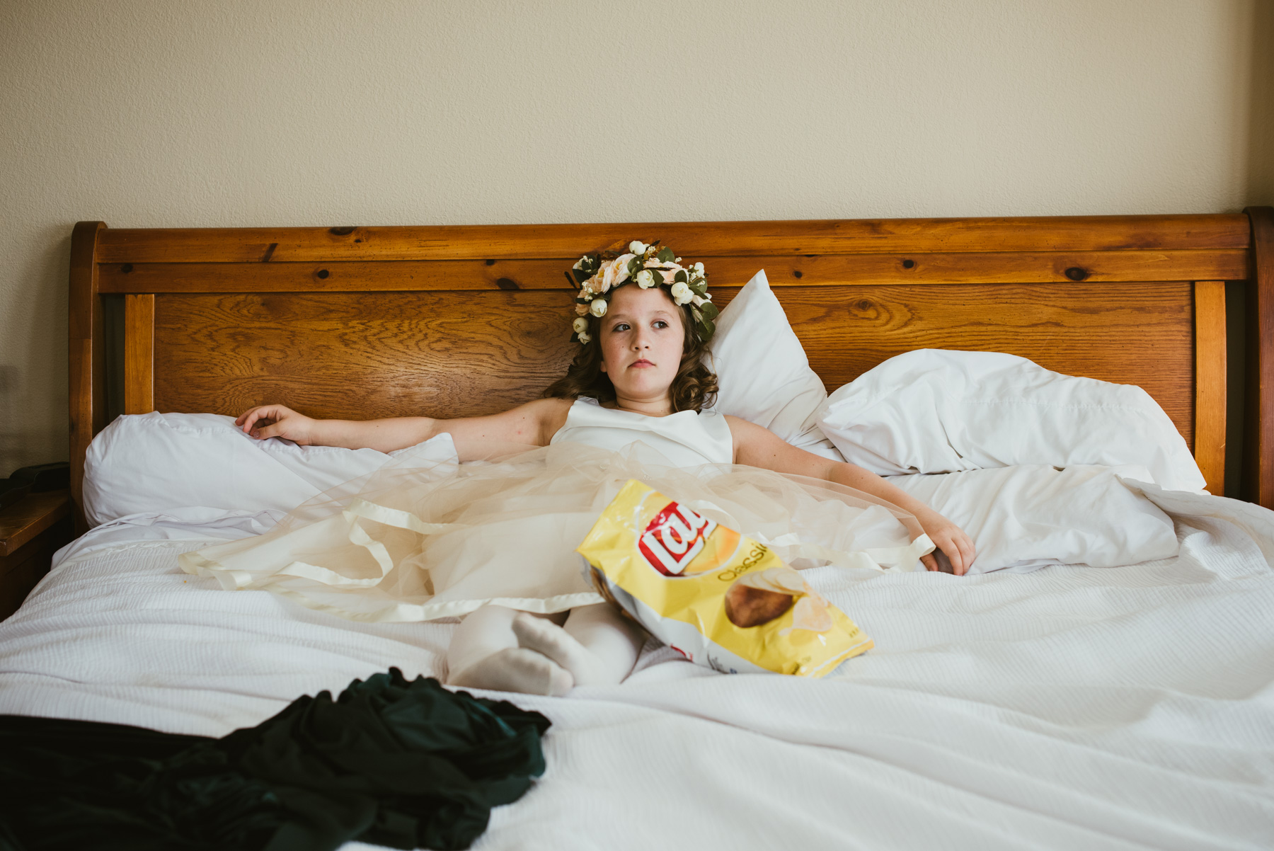 This flower girl was so funny, and so over the getting ready park of the day. Here she is lounging in the room at the Winter Park Mountain Lodge in Winter Park, Colorado. She's ready to get the show on the road!