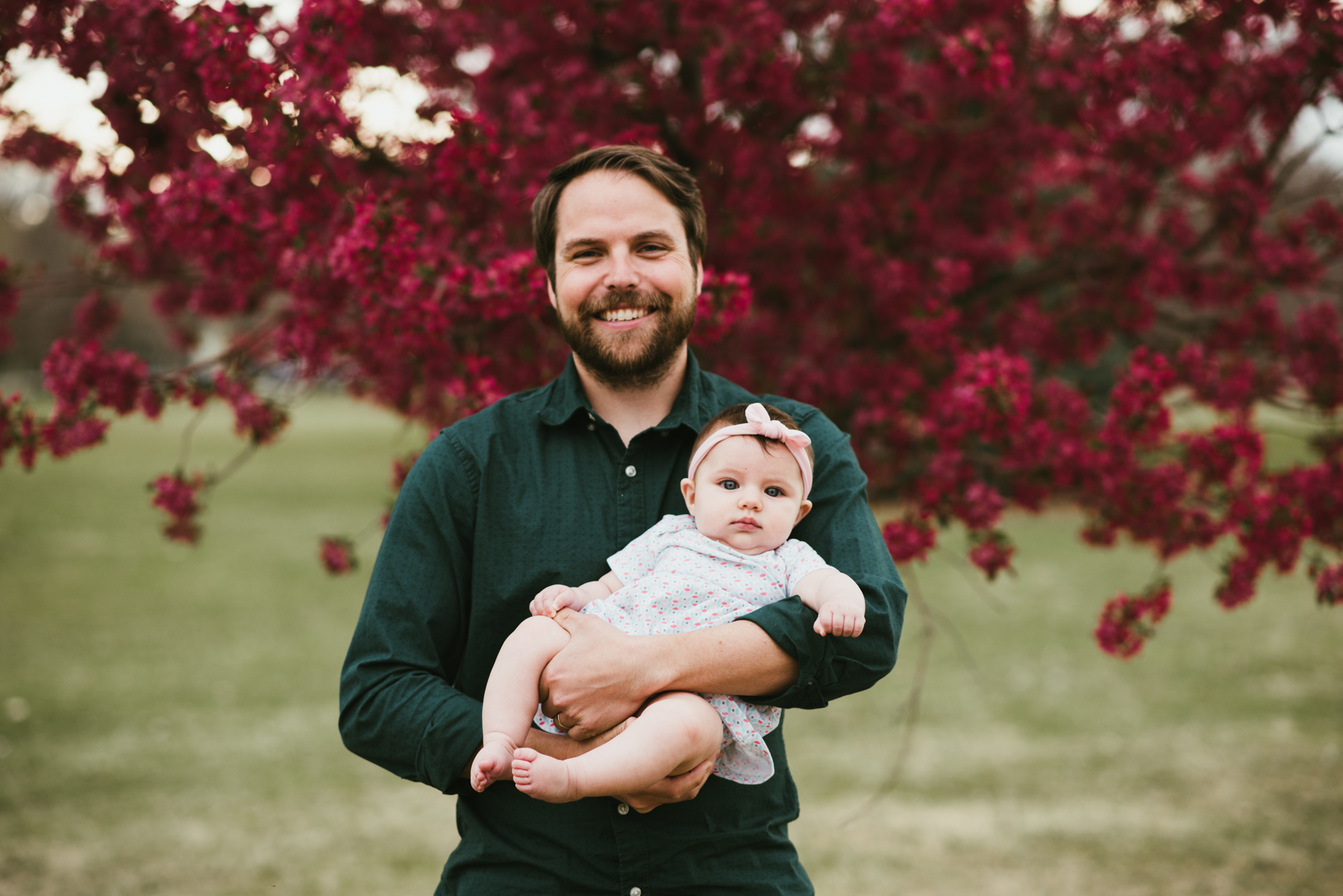 This is my husband Woody, and our daughter Luna, at Sloan's Lake on the first day of spring. It was a beautiful day and we decided to pose in front of these trees that still had some flowers. Luna was 4 months old.