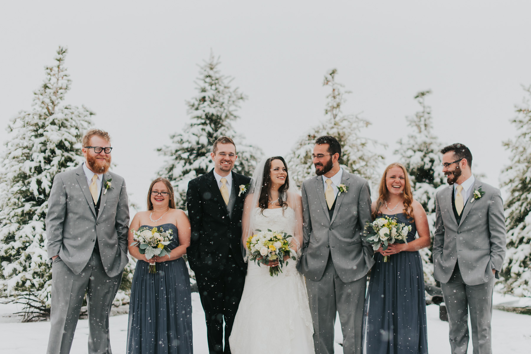 April & Jordan's bridal party braving the cold snow outside of the Windsor Estate Event Center in Windsor, Colorado. The snow was falling so think it looked like they were in the middle of nowhere in the mountains of Colorado.