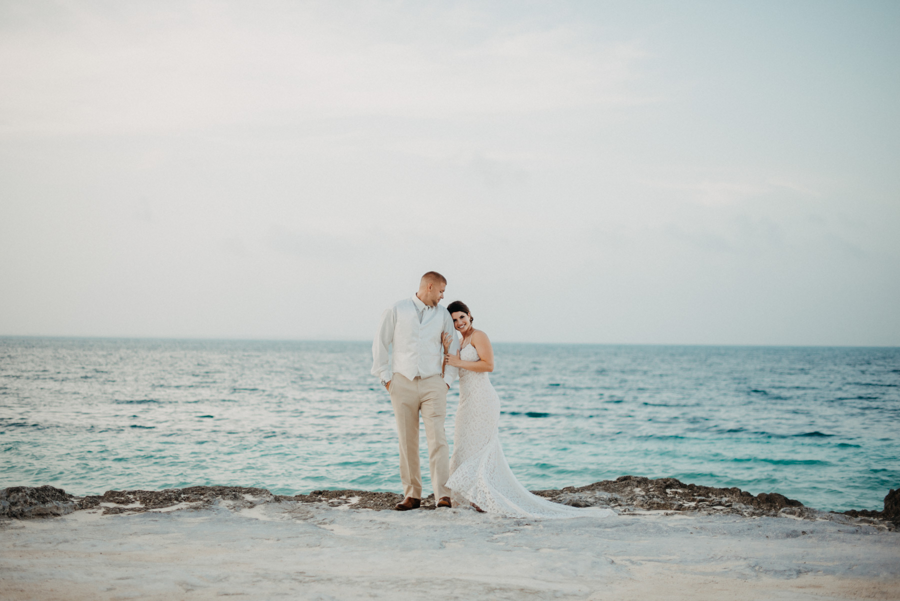 I love every minute of Julia & Tony's Cancun Destination Elopement. The day they got married had a lovely ocean breeze, and Julia's backless boho wedding dress couldn't have been more perfect. I love how they are posed here, with Tony looking down at Julia in front of the gorgeous ocean. I can't believe how blue is was that day. It was so much fun Capturing this fun tropical destination wedding! Copyright: Teresa Woodhull Photography