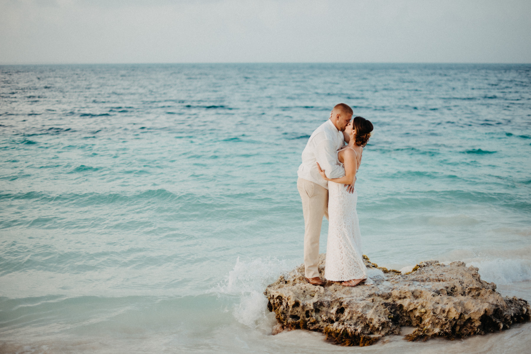 Tony & Julia's Cancun Destination Wedding Elopement could not have been more fun. I asked them if they would mind hopping on this rock, and Julia was all about it! She was they more fun, laid back, boho beach bride. I love photographing beach elopements, and this one in Mexico was a blast!