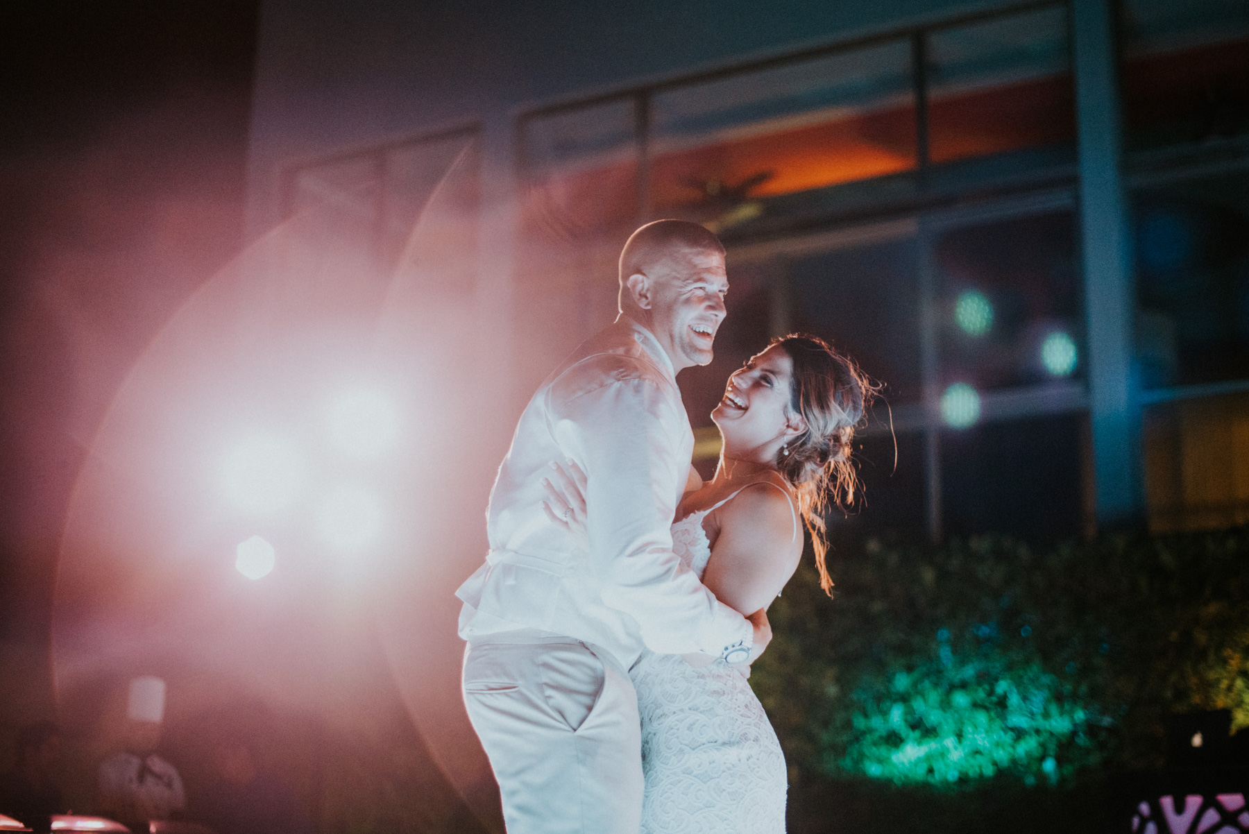 Julia and Tony's first dance during their beach reception. They got married right in front of the ocean and later had their first dance in the same spot. I love how windswept and boho htye look here. Just the right amount of tired and happy. I love photographing their cancun destination wedding elopement.