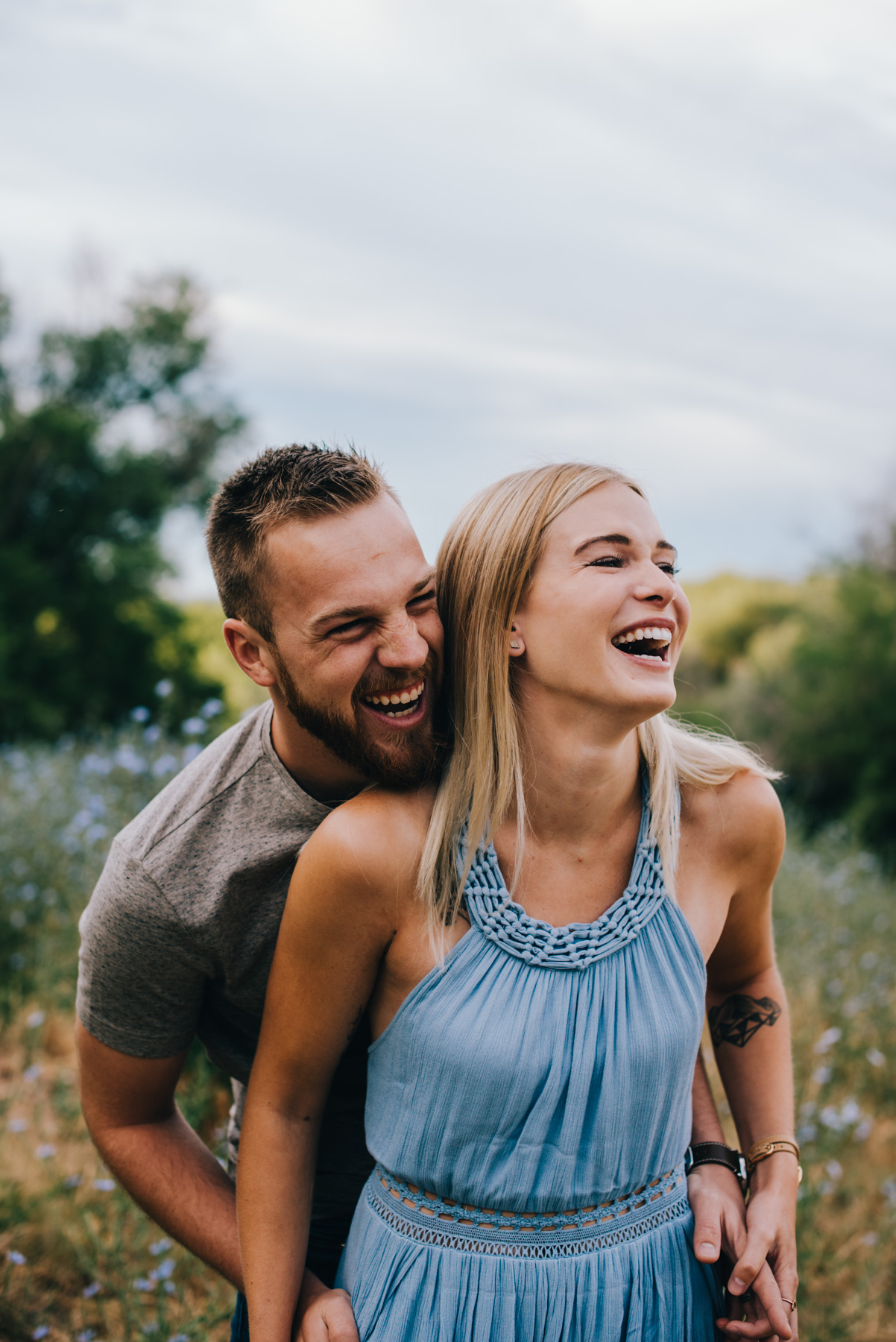 I love when couples can laugh at themselves, and be super comfortable in their skin. Betsy and Connor were so in sync for their Mount Sanitas engagement session in Boulder Colorado. I love the blue dress she was wearing, and that she was all about hiking in it as long as their adorable puppy Teddy could join. Copyright: Teresa Woodhull Photography