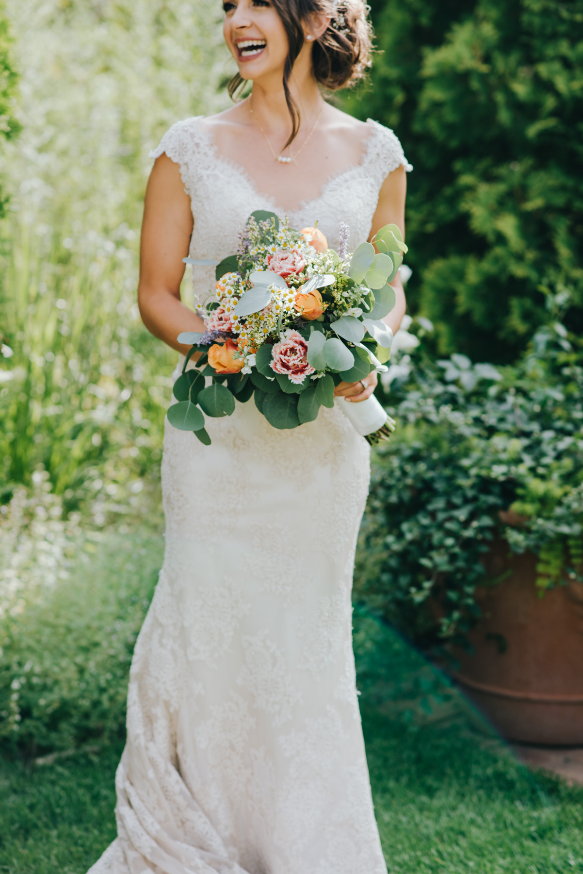 Jamie on her wedding day at the Denver Botanic Gardens. Here she is right before the ceremony, holding her gorgeous bouquet (which she got from Whole Foods!)