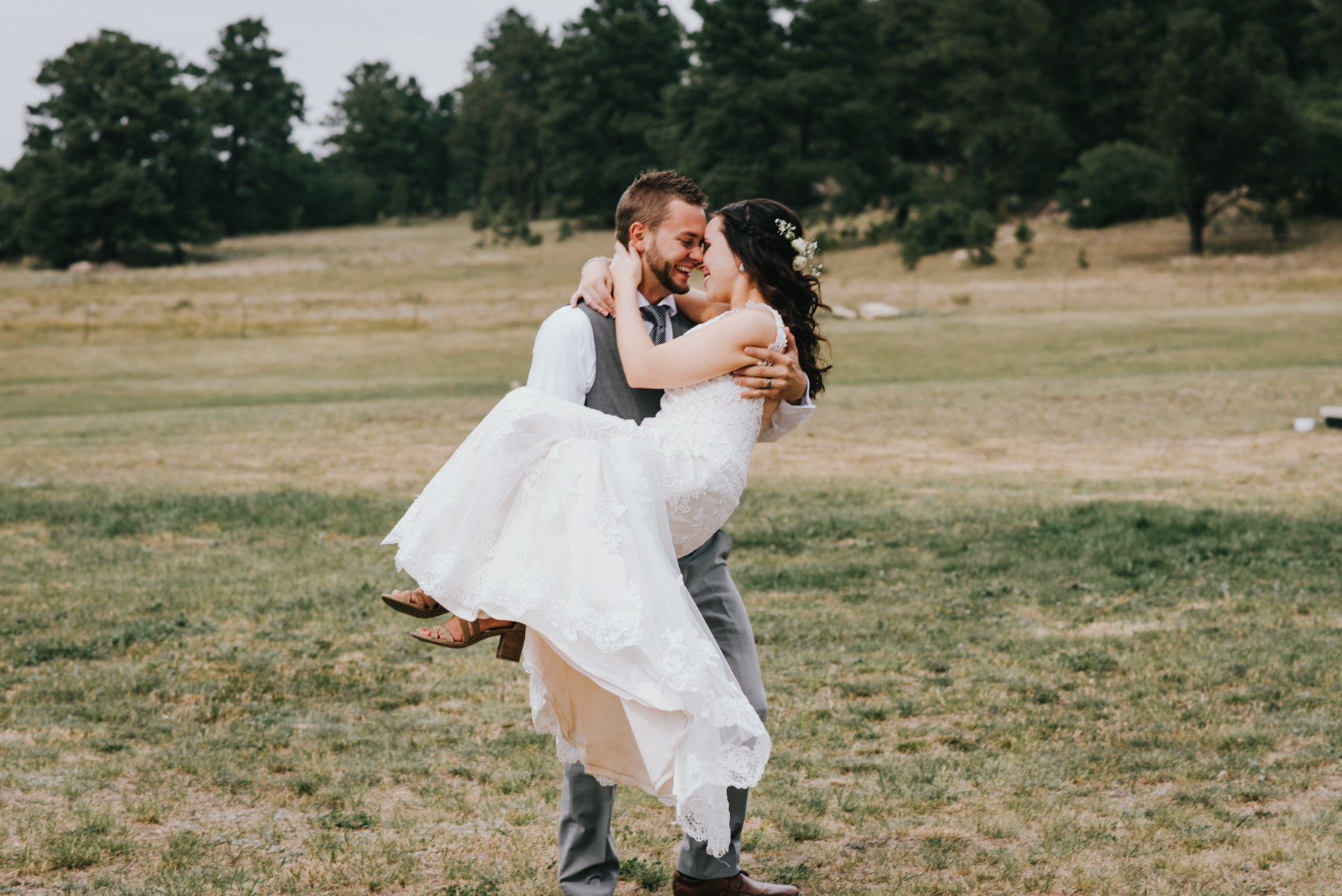 Lynsey is in Chris's arms here as they spin around on their wedding day at the Flying Horse Ranch in Colorado Springs. Copyright: Teresa Woodhull Photography