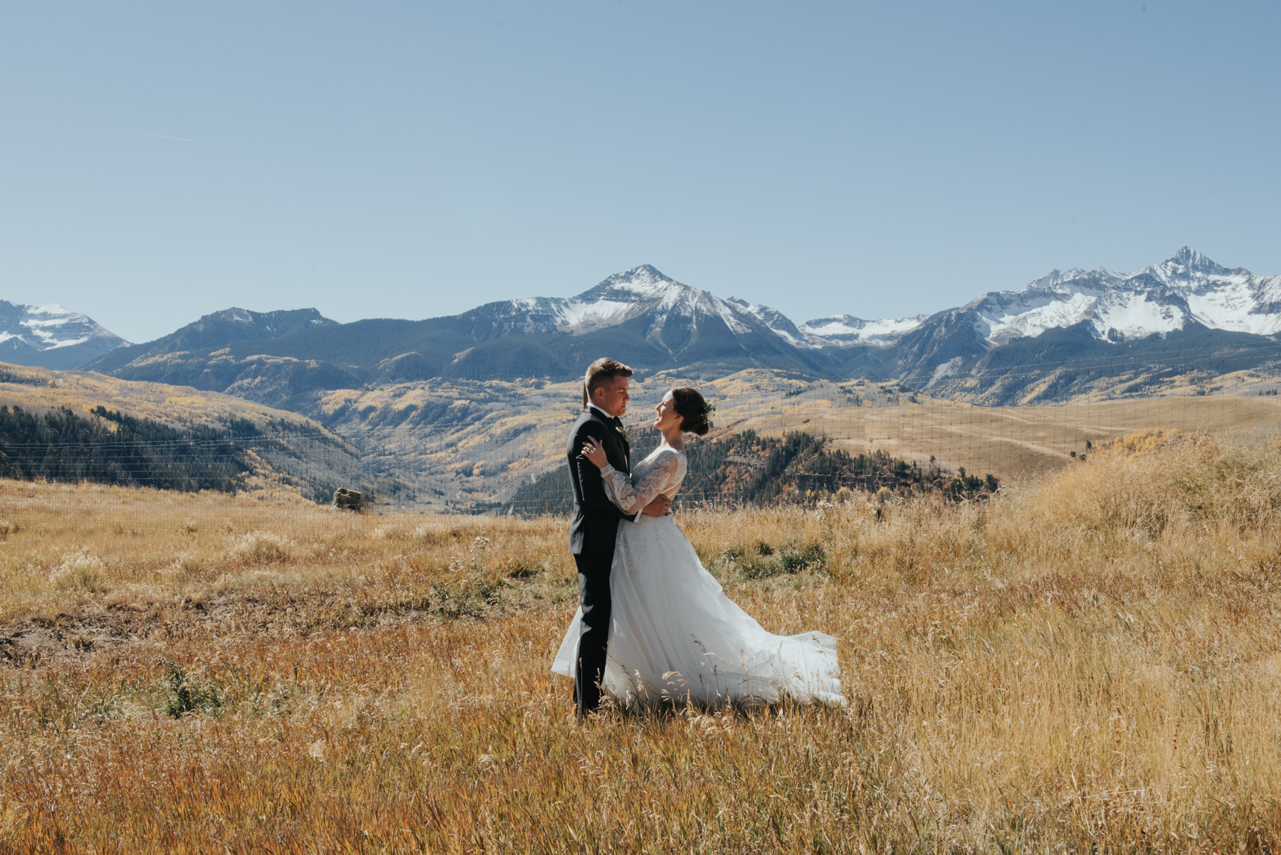 Elyse and Stefan during their first look. This bride and groom decided to have a destination wedding in Telluride, Colorado. They had their epic mountain top first look just outside of Telluride at the Telluride Airport.