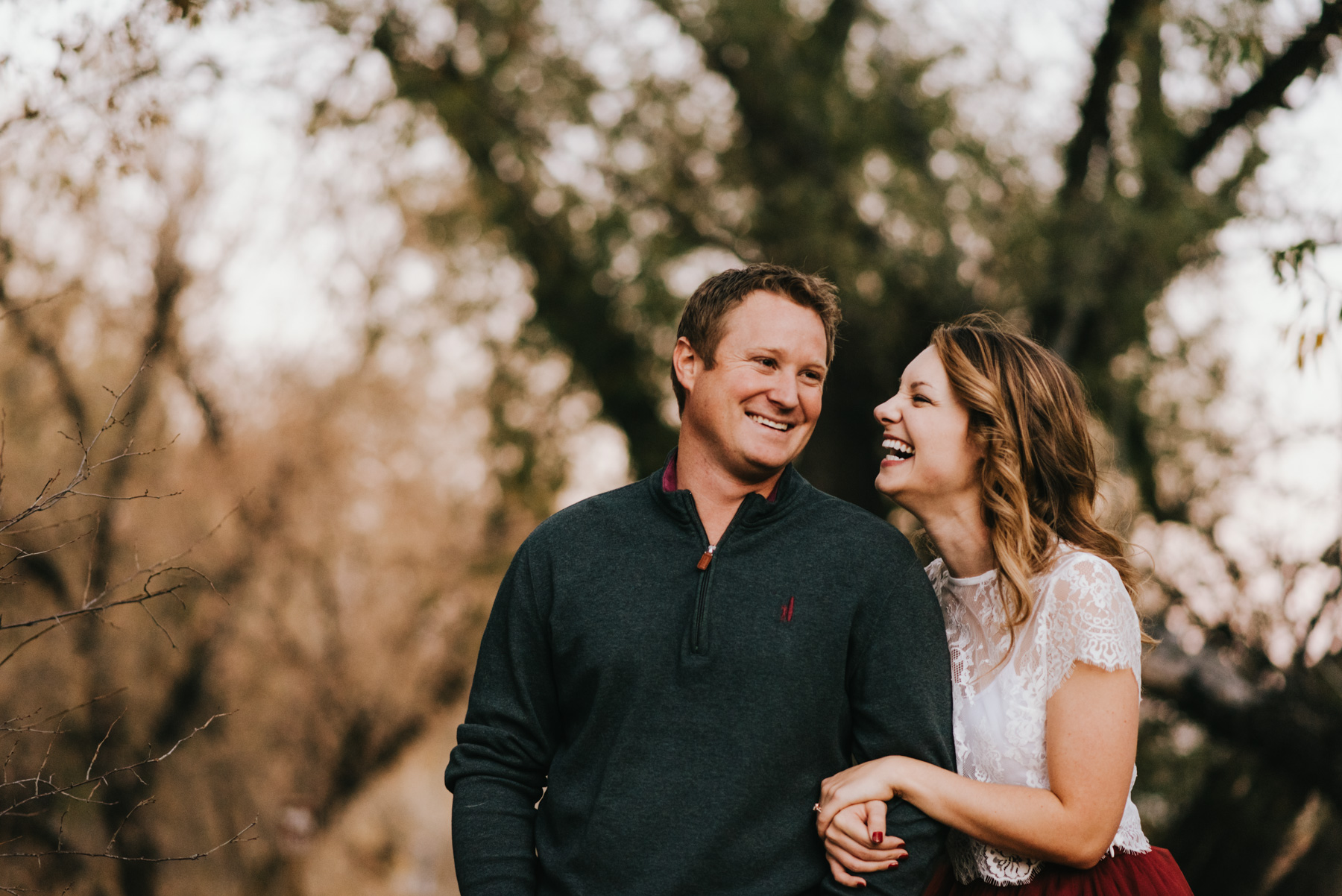 I love how they are laughing here during their late fall engagement session in Denver, Colorado.