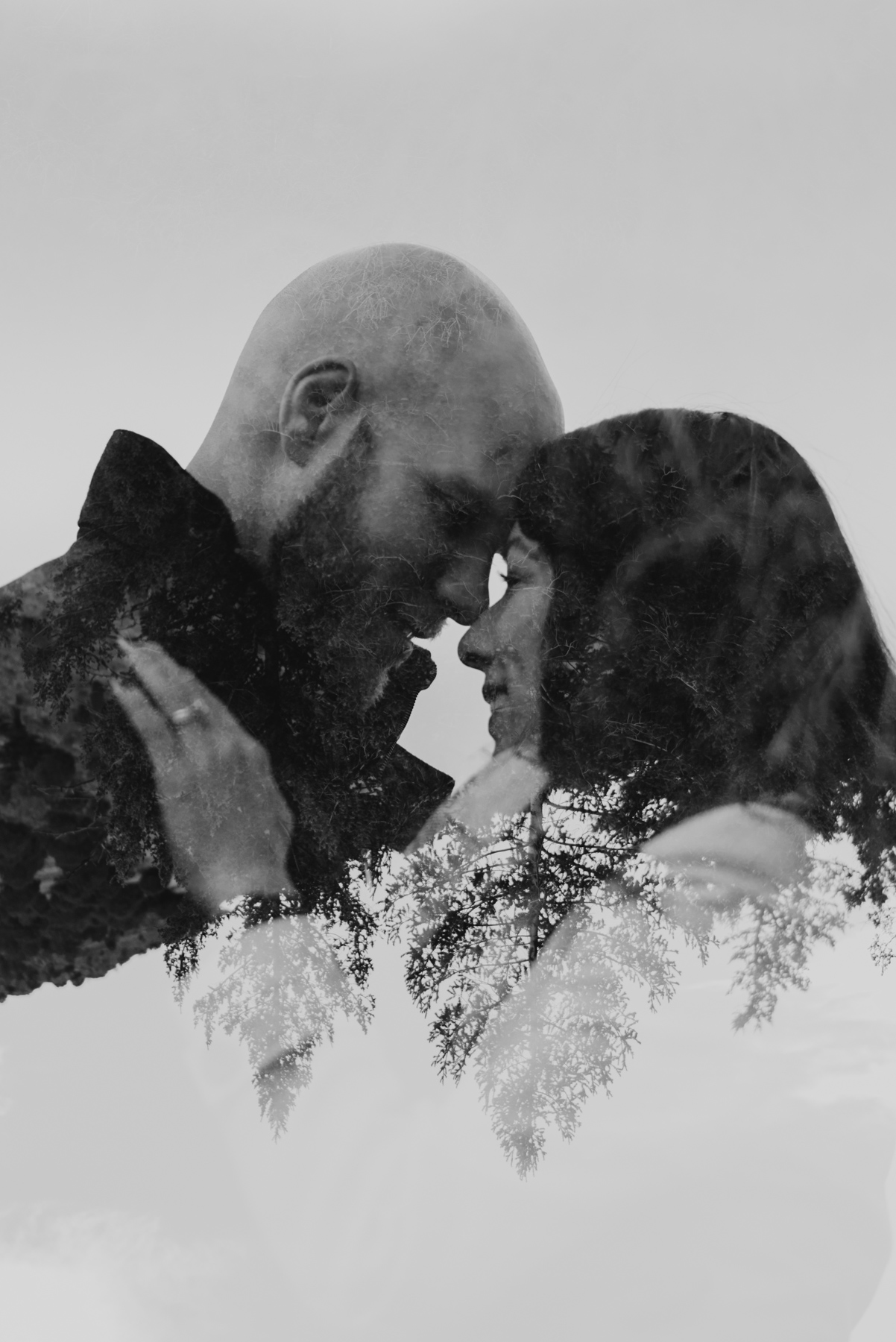 A black and white double exposure of Daisy and Brett during their Anniversary photo session at Red Rocks Park and Amphitheatre.