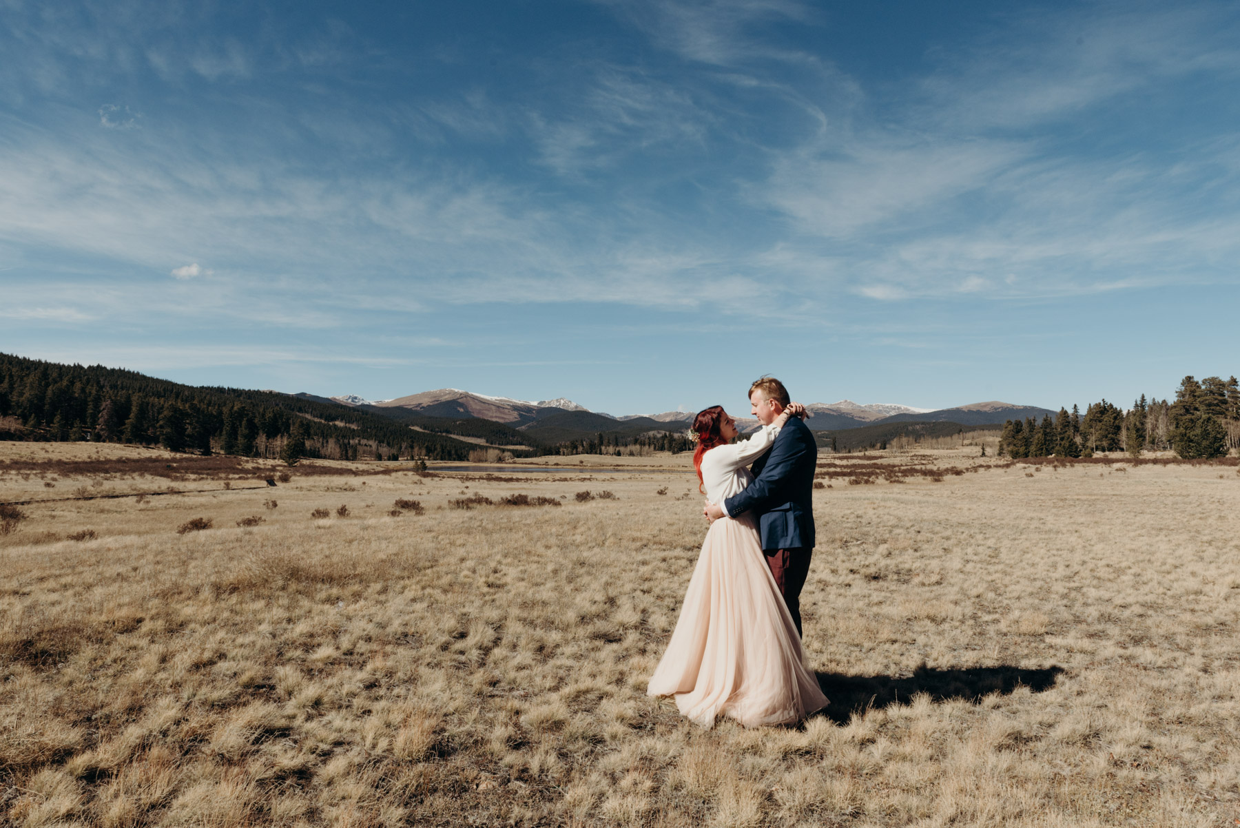 Megan and Chris, slow dancing in a field shortly before their wedding in Kenosha Pass. Megan made the most beautiful mountain bride.