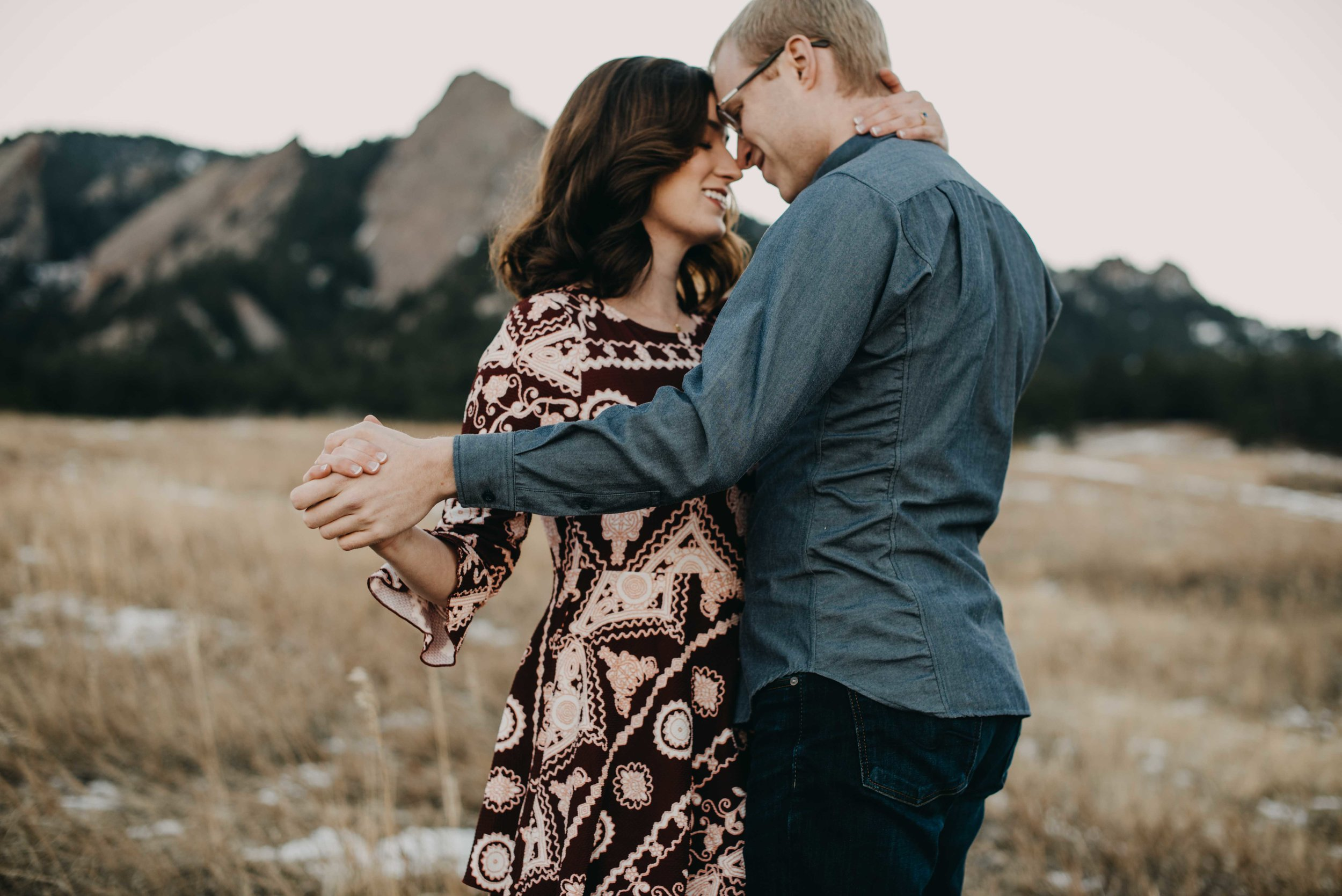 Trinity and Peter dancing in front of the flatirons during their Chautauqua engagement session. They came in from Houston to have a hiking portrait session and we had a blast, despite the bitter cold!